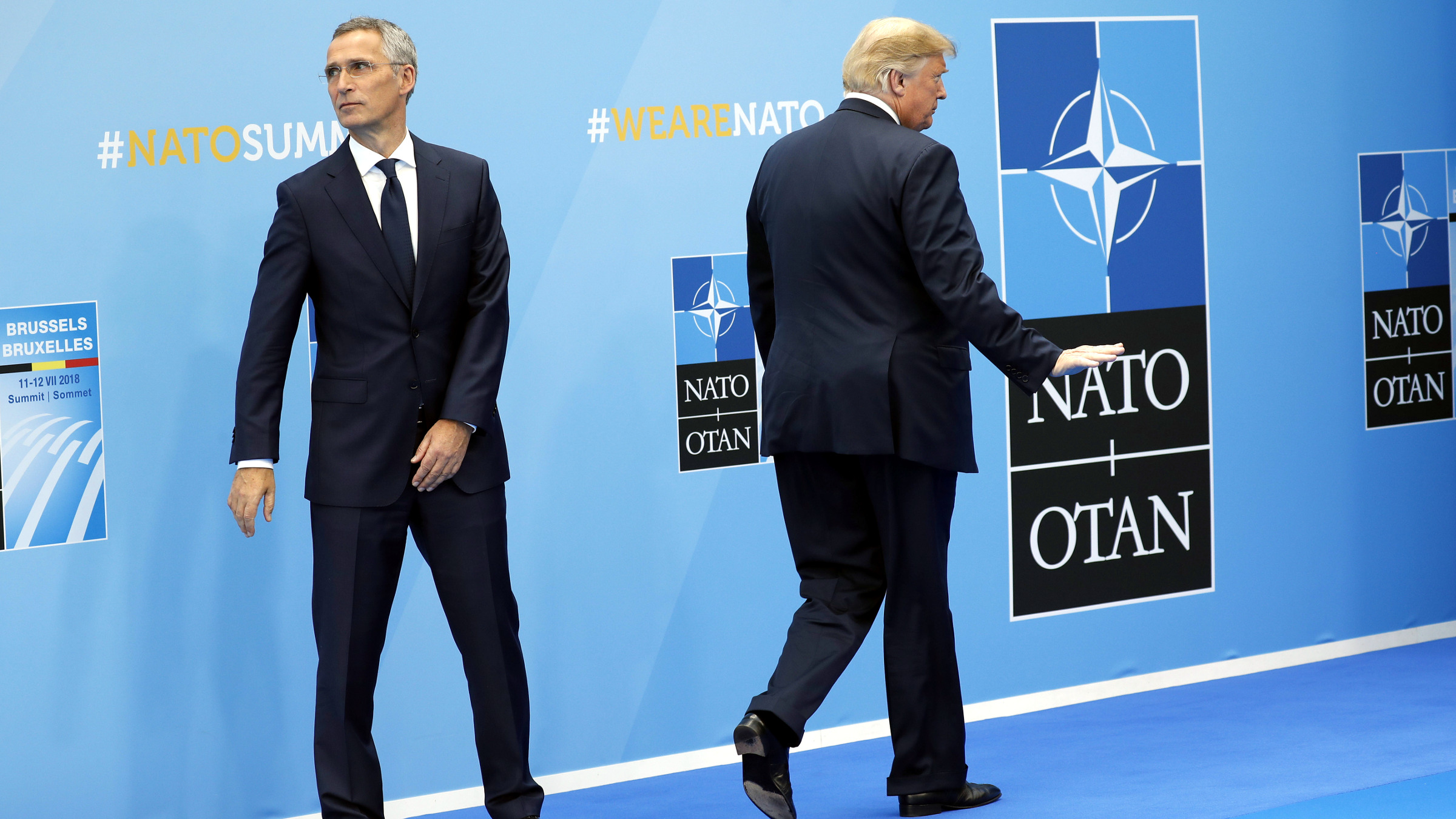 President Donald Trump gestures as he walks away after being greeted by NATO Secretary General Jens Stoltenberg, left, before a summit of heads of state and government at NATO headquarters in Brussels on Wednesday, July 11, 2018. NATO leaders gather in Brussels for a two-day summit to discuss Russia, Iraq and their mission in Afghanistan.