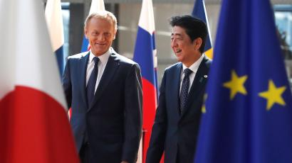 Japan's Prime Minister Shinzo Abe (R) is welcomed by European Council President Donald Tusk at the start of a European Union-Japan summit in Brussels, Belgium July 6, 2017.