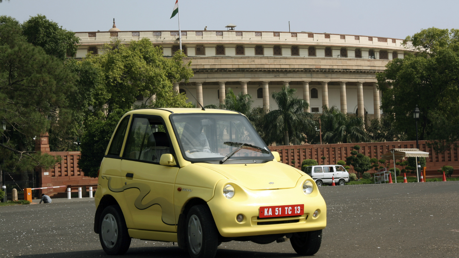 """The new-generation Revai electric car is seen in this undated photo near the Indian Parliament building in New Delhi. Long before """"green"""" cars became cool in most parts of the world, a relatively unknown Indian industrialist, Chetan Maini, set up a venture in the mid 1990s to make electric cars in Bangalore, known better as a software services hub. Today, several Revai electric cars can be seen tootling along Bangalore's crowded streets, their bright colours, clean lines and minimalist design drawing curious looks, and smiles, even from harried commuters."""