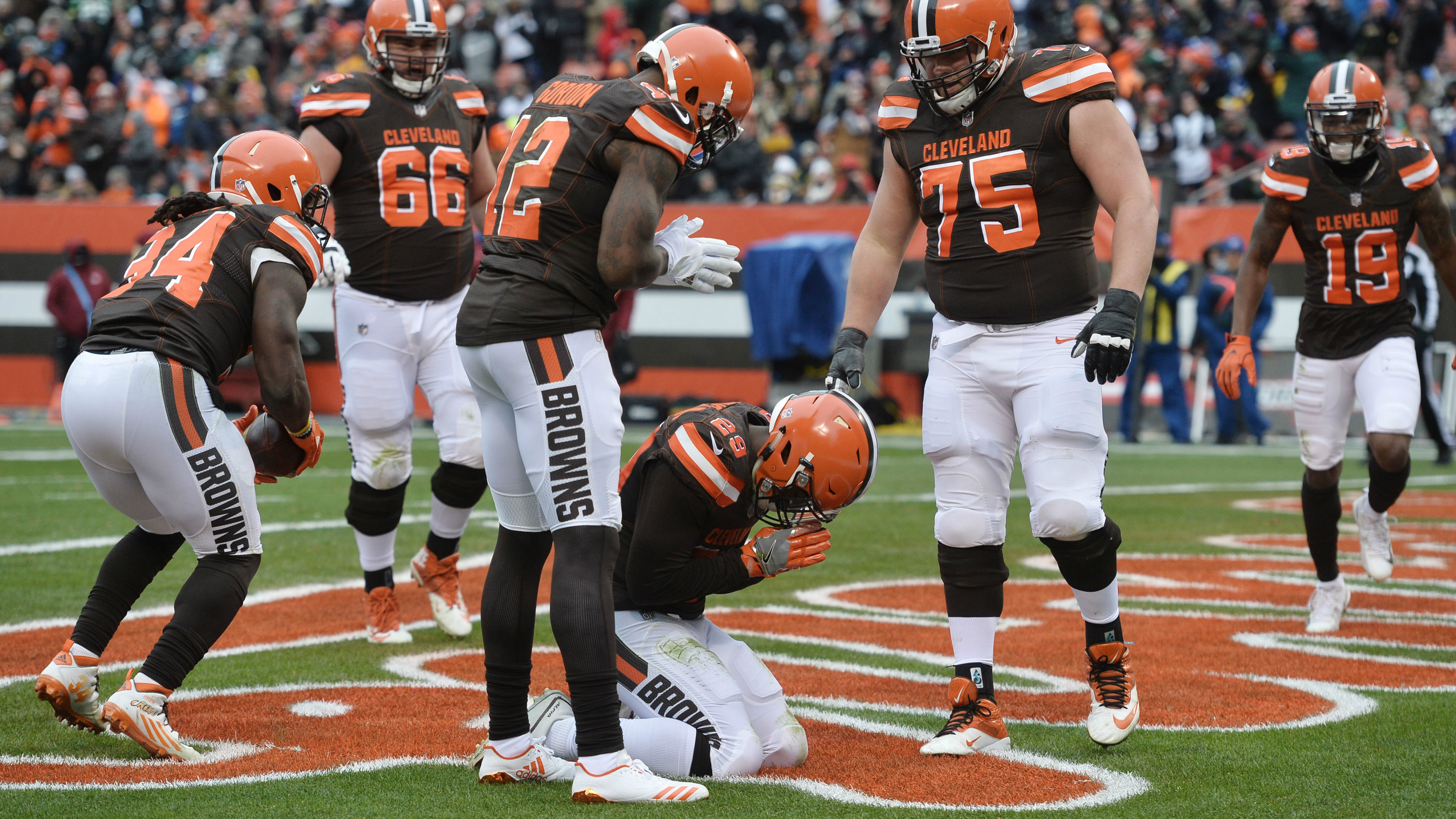 A football player praying after scoring a
