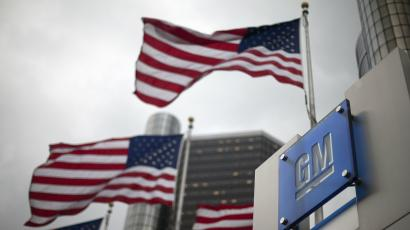 American flags fly at GM's headquarters in Detroit