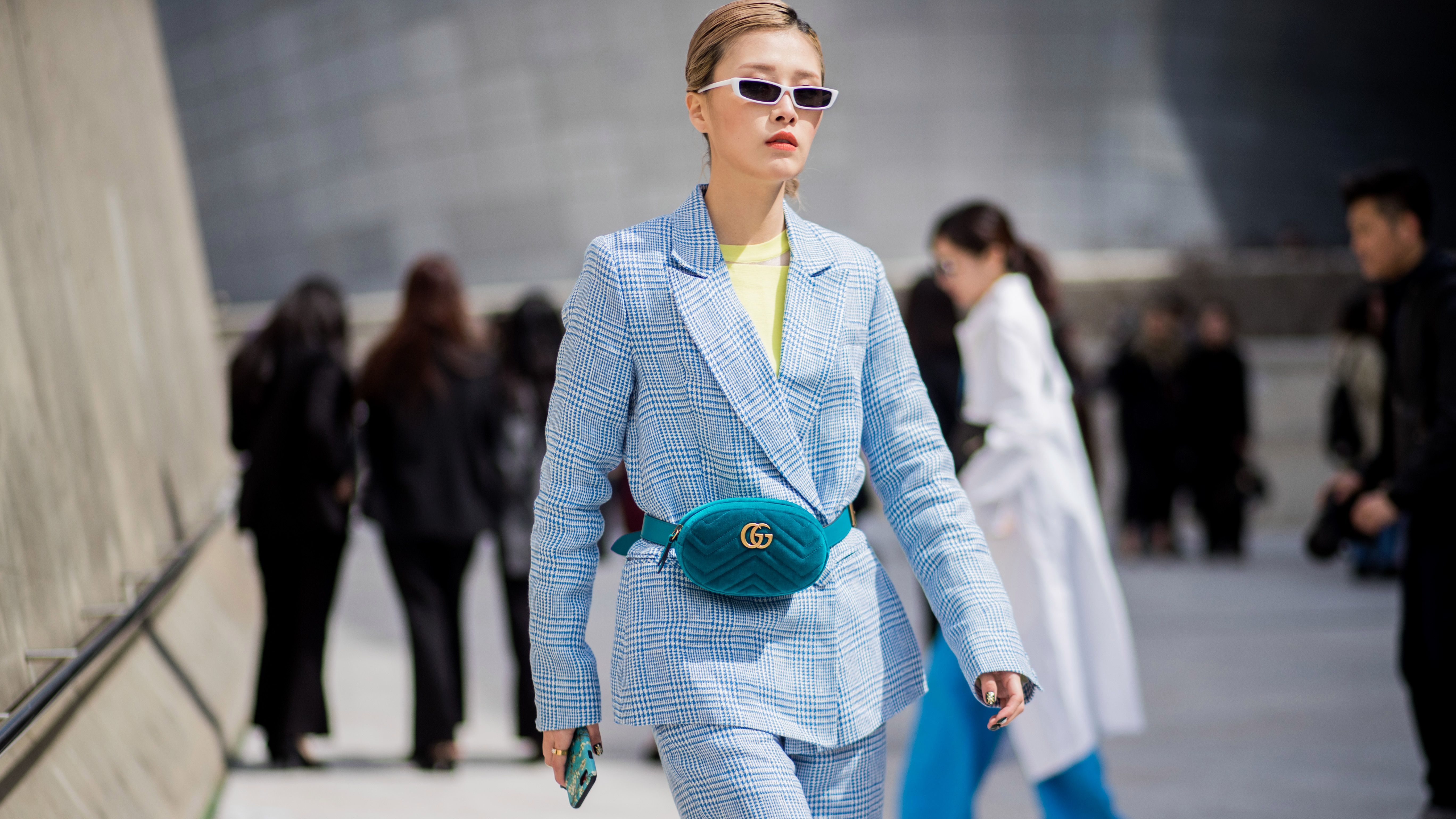SEOUL, SOUTH KOREA - MARCH 20: A guest wearing velvet Gucci funny bag, blue suit is seen at the Hera Seoul Fashion Week 2018 F/W at Dongdaemun Design Plaza on March 20, 2018 in Seoul, South Korea. (Photo by Christian Vierig/Getty Images)