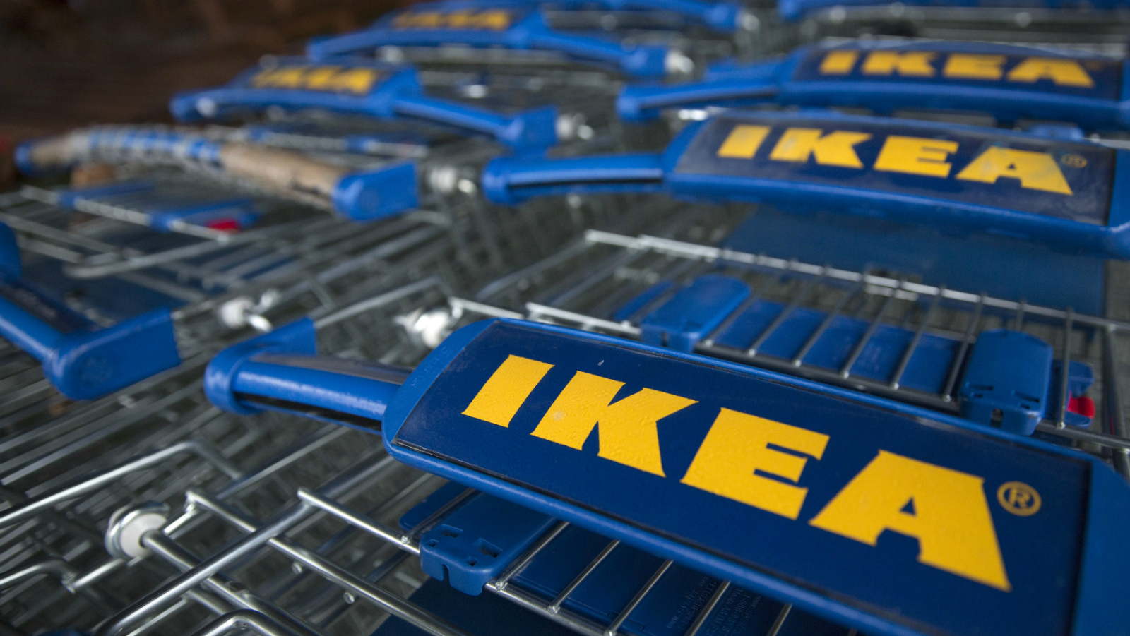 Trollies are seen outside an IKEA store in Wembley, north London January 28, 2015. IKEA Group, the world's biggest furniture retailer, posted on Wednesday a fiscal full-year net profit that was unchanged from the year before and said the European market continued to improve.
