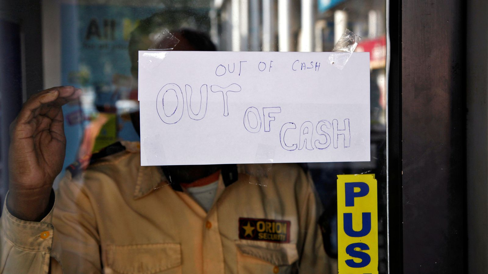 A notice is displayed on the gate of an automated teller machine (ATM) counter which is no longer dispensing cash in Chandigarh, India, November 21, 2016.