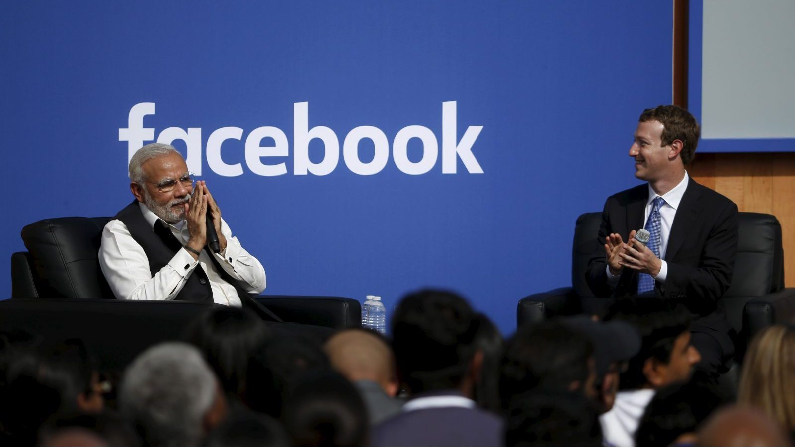 "Indian Prime Minister Narendra Modi (L) gives a ""namaste"", a gesture of greeting, as Facebook CEO Mark Zuckerberg applauds on stage after a town hall at Facebook's headquarters in Menlo Park, California September 27, 2015. REUTERS/Stephen Lam - GF10000223695"