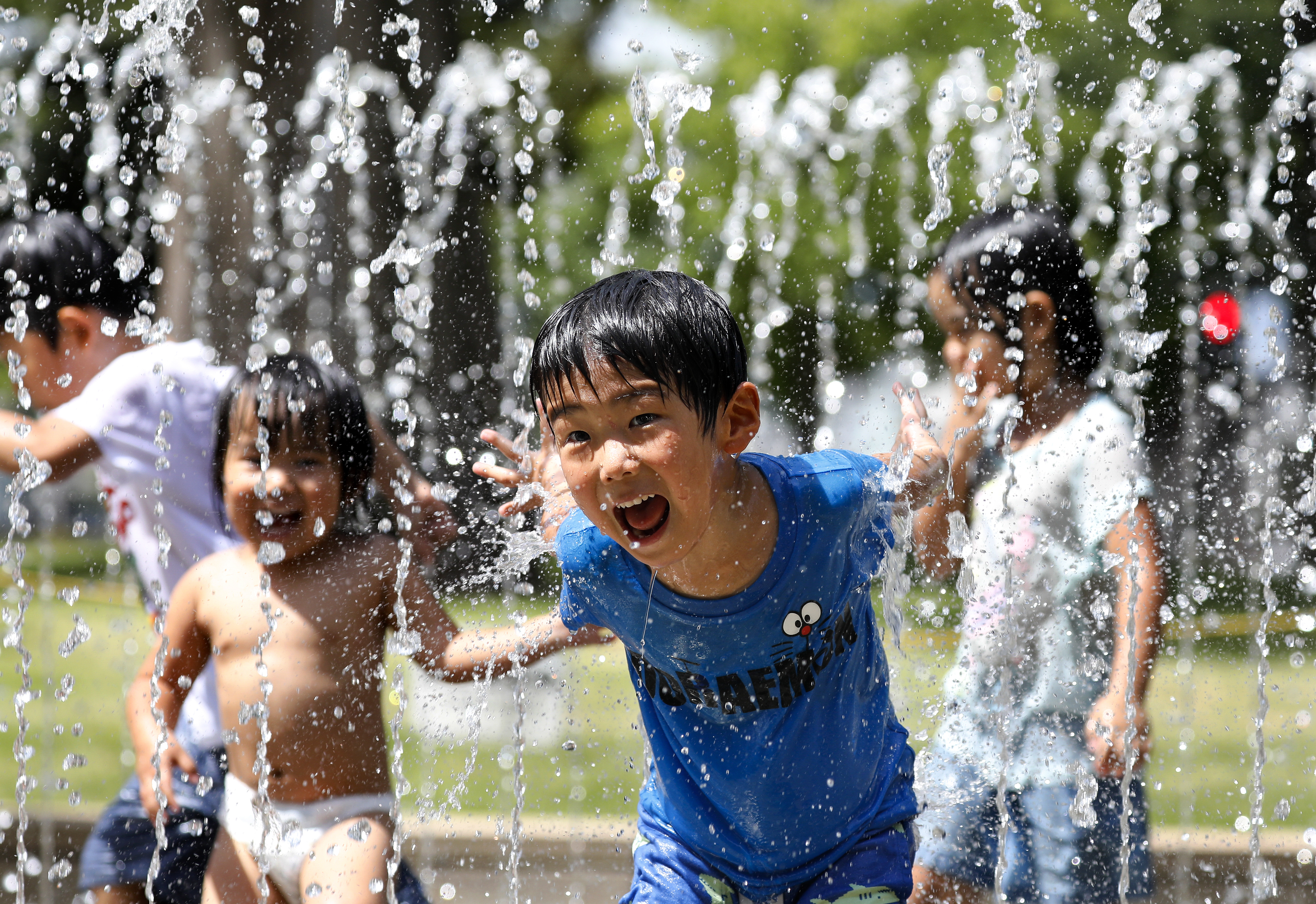 Children play in the water jets at a park near Nerima in Tokyo as temperature rose up to 39.6 degrees Celsius, the highest temperature since the start of weather information record. While central Tokyo hit the 39 degrees mark, the city of Kumagaya, north of Tokyo measured 41.1 degrees Celsius , the yet highest temperature in Japan. From the end of April to mid-July 2018, reportedly so far 21,166 people were taken to hospital for heat related problems, alone from 09 to 15 July, a total of 9,956 people were hospitalized due to suffering from the hot weather conditions, Japan's Fire and Disaster Management Agency said.