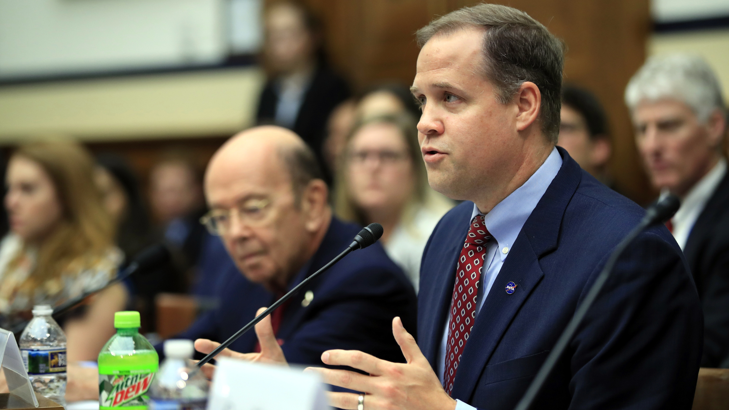 NASA Administrator Jim Bridenstine with Commerce Secretary Wilbur Ross, left, testifies before a House Committee on Science, Space, and Technology Space Subcommittee and House Armed Services Committee Strategic Forces Subcommittee joint hearing on 'Space Situational Awareness: Whole of Government Perspectives on Roles and Responsibilities' on Capitol Hill in Washington, Friday, June 22, 2018.