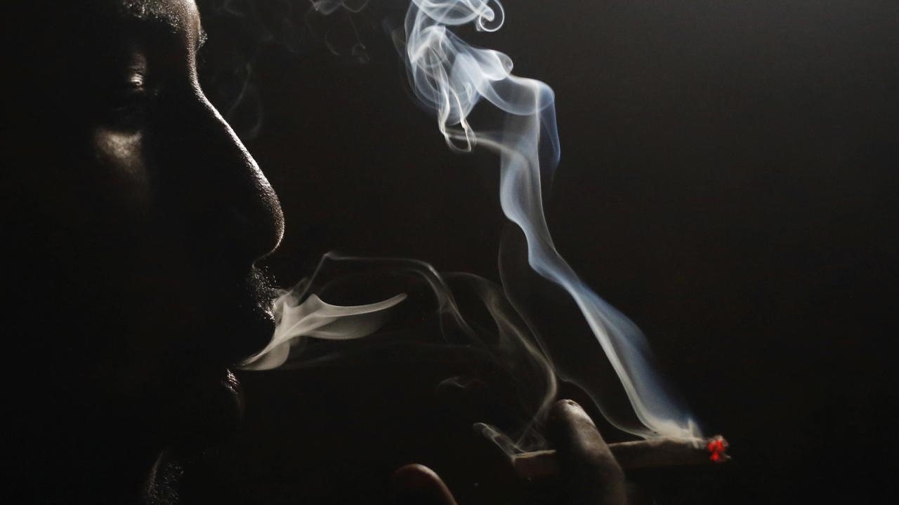 A heroin addict smokes heroin in Lamu November 21, 2014. Picture taken November 21, 2014.   To match KENYA-DRUGS/LAMU     REUTERS/Goran Tomasevic (KENYA - Tags: DRUGS SOCIETY) - GM1EB351DTO01