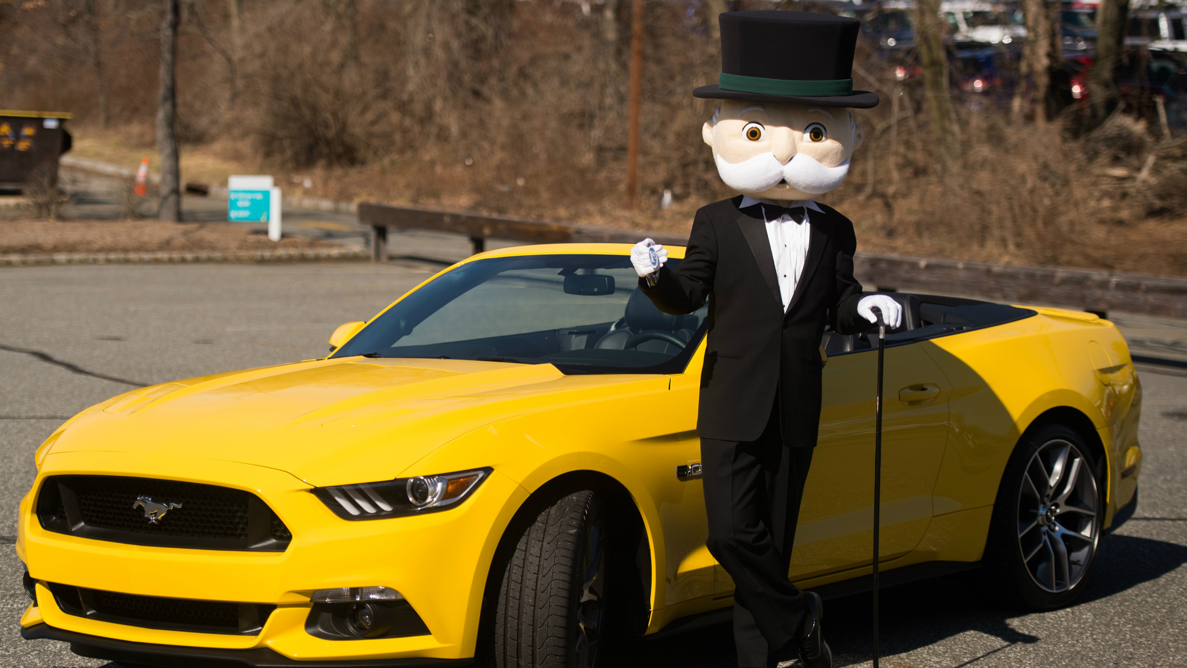 MR. MONOPOLY gears up to enjoy a ride in a Ford Mustang.
