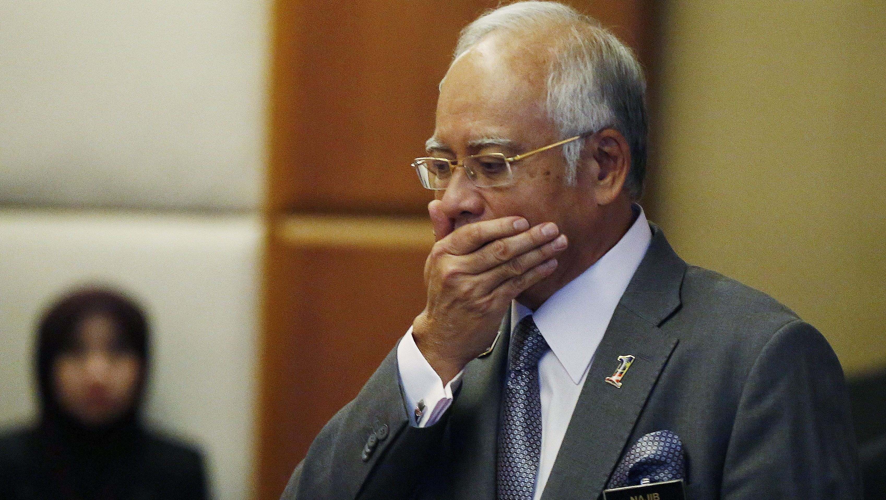 Malaysia's Prime Minister Najib Razak arrives at a presentation for government interns at the Prime Minster's office in Putrajaya, Malaysia, July 8, 2015. Malaysian police raided the office of troubled state investment fund 1MDB on Wednesday, following a report that claimed investigators looking into the firm found nearly $700 million had been transferred to Prime Minister Najib Razak's bank account. Najib has denied taking any money from 1MDB or any other entity for personal gain, and is considering legal action. REUTERS/Olivia Harris TPX IMAGES OF THE DAY - GF10000152317