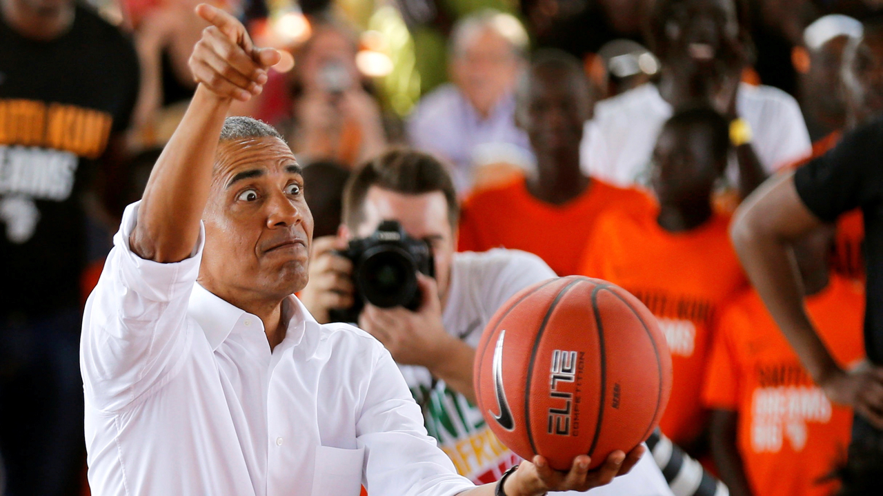 Former U.S. President Barack Obama reacts as he addresses players at the basketball court during the launch of Sauti Kuu resource centre near his ancestral home in Nyangoma Kogelo village in Siaya county, western Kenya July 16, 2018. REUTERS/Thomas Mukoya - RC162D4E38B0