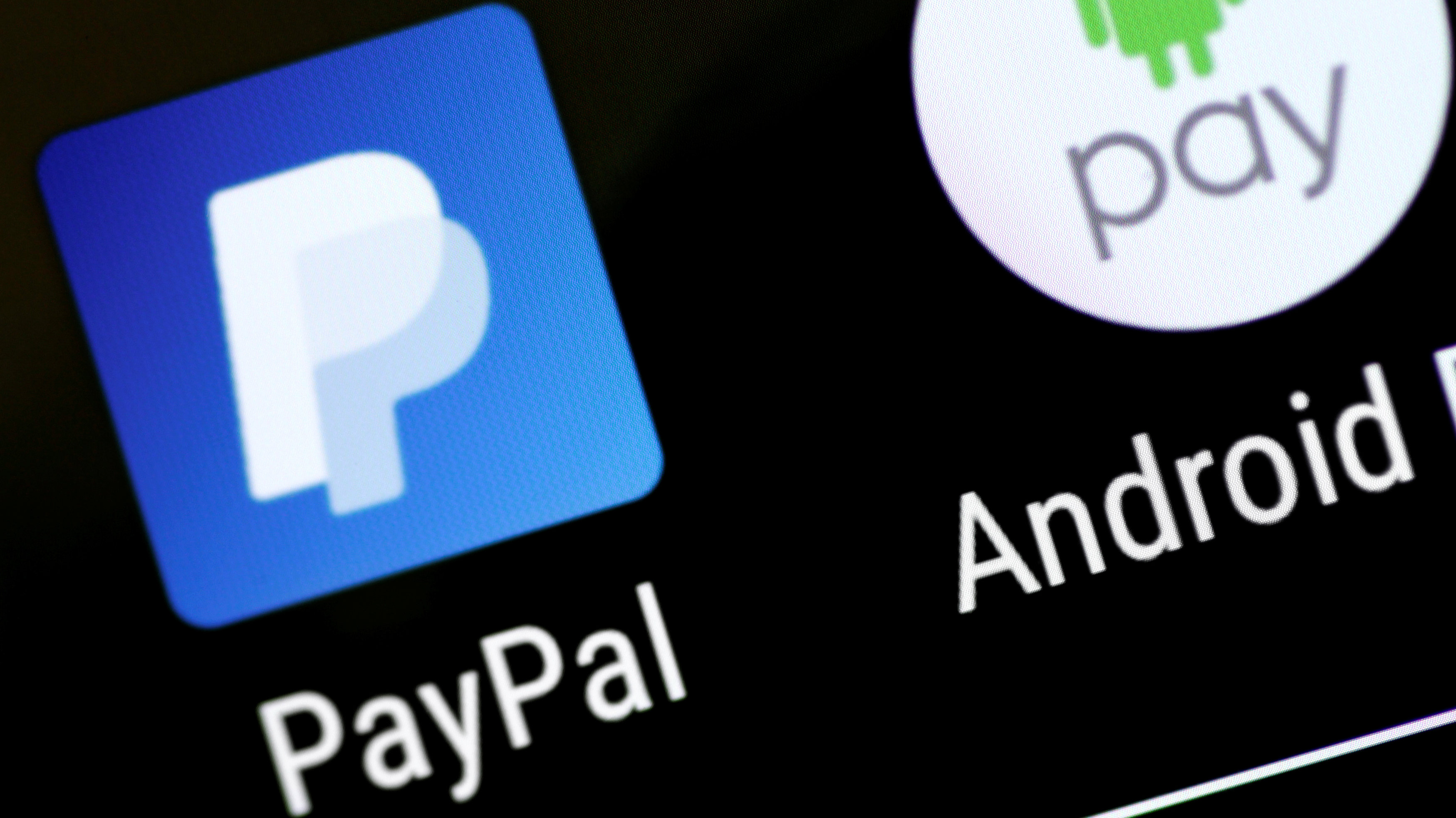 The PayPal and Android Pay apps are seen on a mobile phone in this illustration photo October 16, 2017.