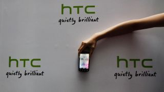 A new HTC Android-based smartphone Sensation is displayed during a news conference for the launch of the product in Taipei May 27, 2011. The mobile phone which was launched on Friday, features a 4.3 inch display screen and is priced at NT20,900 or ($725). REUTERS/Pichi Chuang (TAIWAN - Tags: SCI TECH BUSINESS) - GM1E75R18WT01