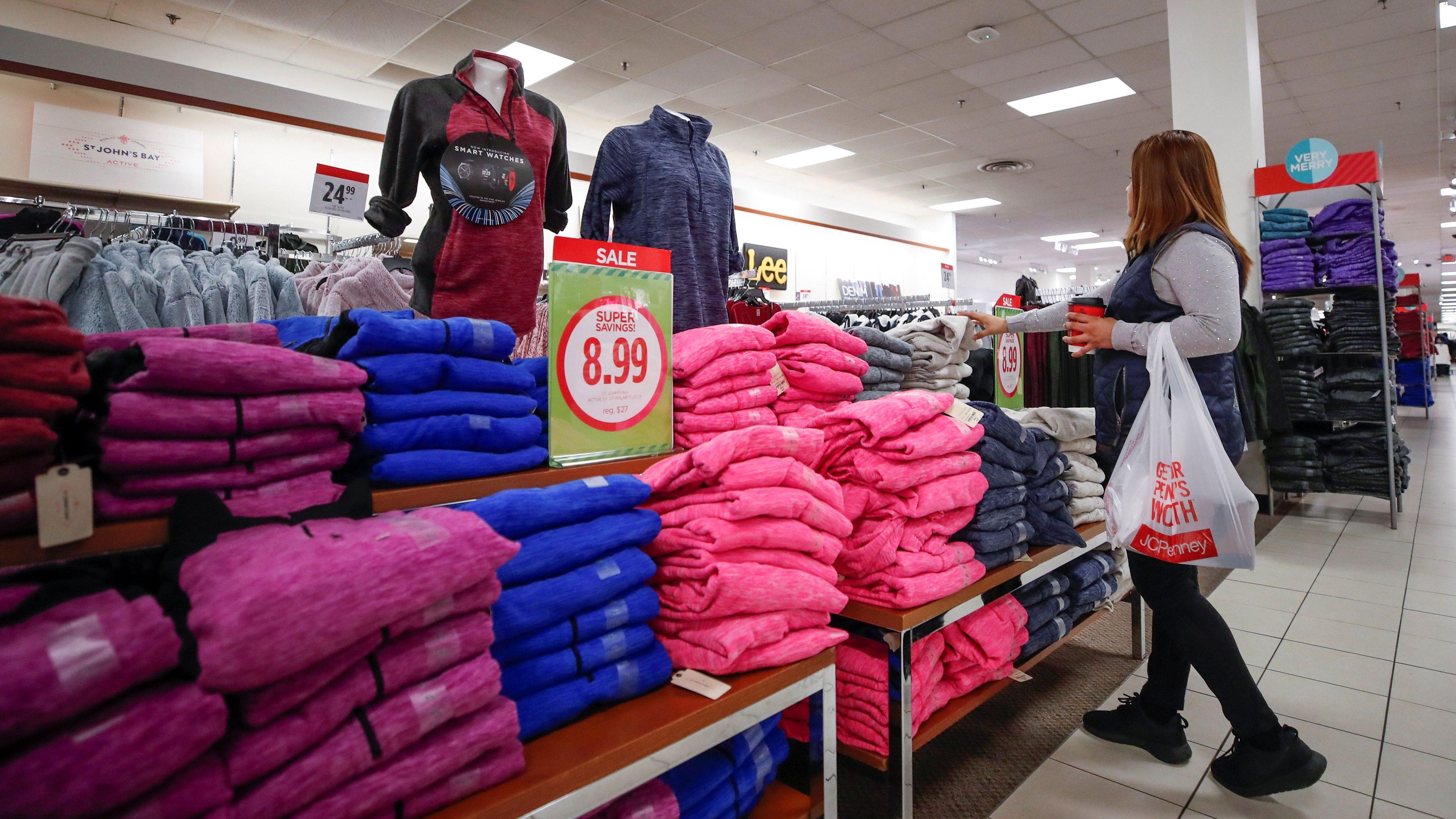 A shopper checks on merchandise at the J.C. Penney department store in North Riverside, Illinois, U.S., November 17, 2017. REUTERS/Kamil Krzaczynski - RC1ED0618480