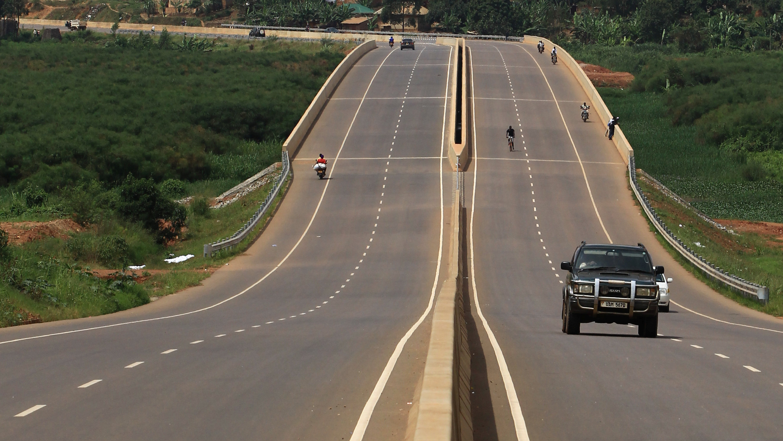 Vehicle drives on new expressway in Kampala
