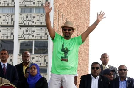 Ethiopian Prime Minister Abiy Ahmed waves to supporters as he attends a rally in Addis Ababa, Ethiopia June 23, 2018.
