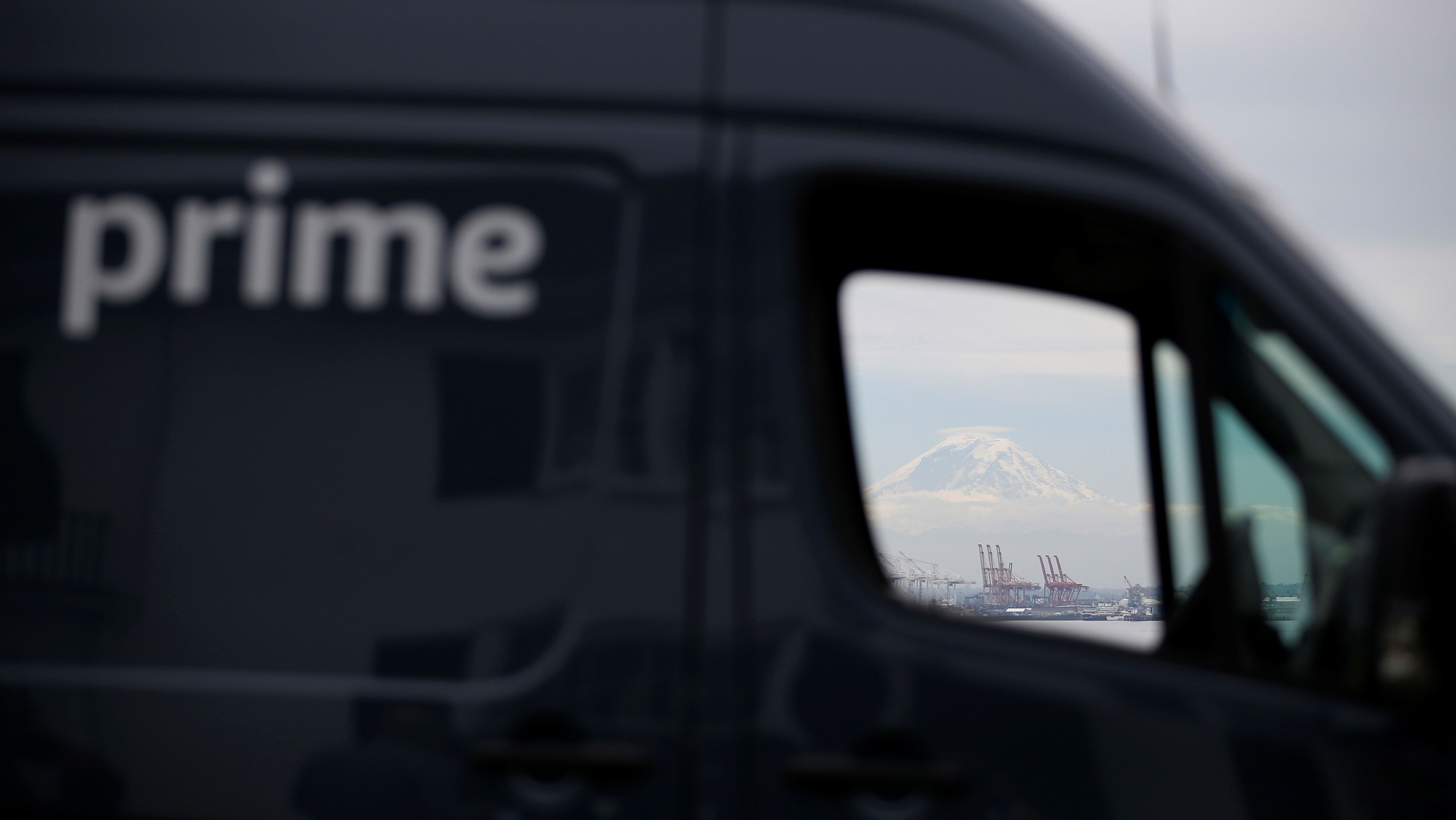 Mt. Rainier can be seen through the window of an Amazon Prime van during a press conference announcing Amazon.com's new program to help entrepreneurs build businesses delivering Amazon packages, including $1 million to fund startup costs for military veterans, in Seattle, Washington, U.S., June 27, 2018.  REUTERS/Lindsey Wasson - RC1FDFB50AC0