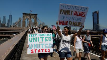 """Demonstrators march on Brooklyn Bridge during """"Keep Families Together"""" march to protest Trump administration's immigration policy in New York"""