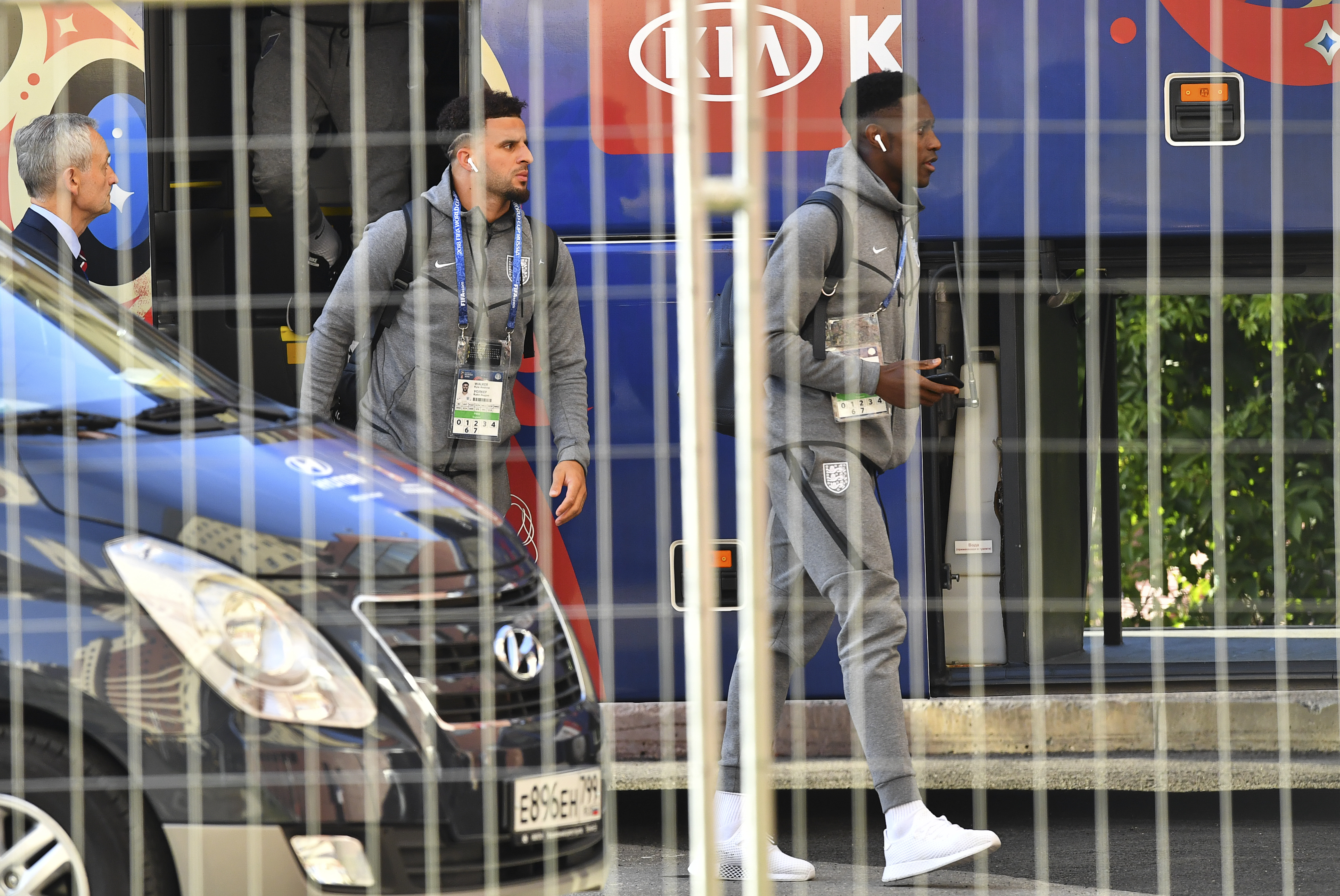 Soccer Football - World Cup - England Arrival - Samara, Russia - July 6, 2018. Kyle Walker and Danny Welbeck walk out of a bus as they arrive at a hotel. REUTERS/Dylan Martinez - UP1EE7616Q2FO
