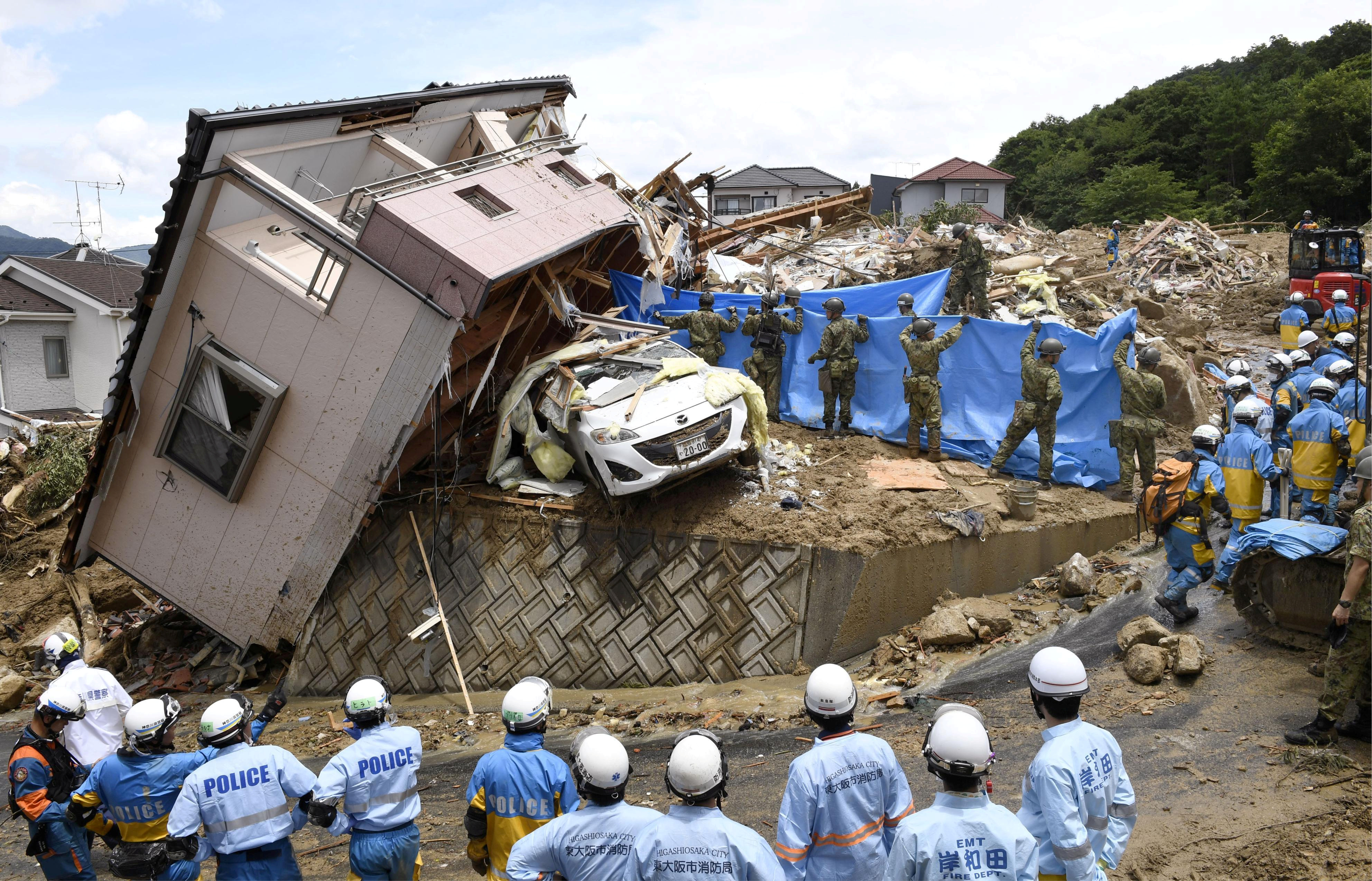 Western Japan floods: Photos of the floods that have ...