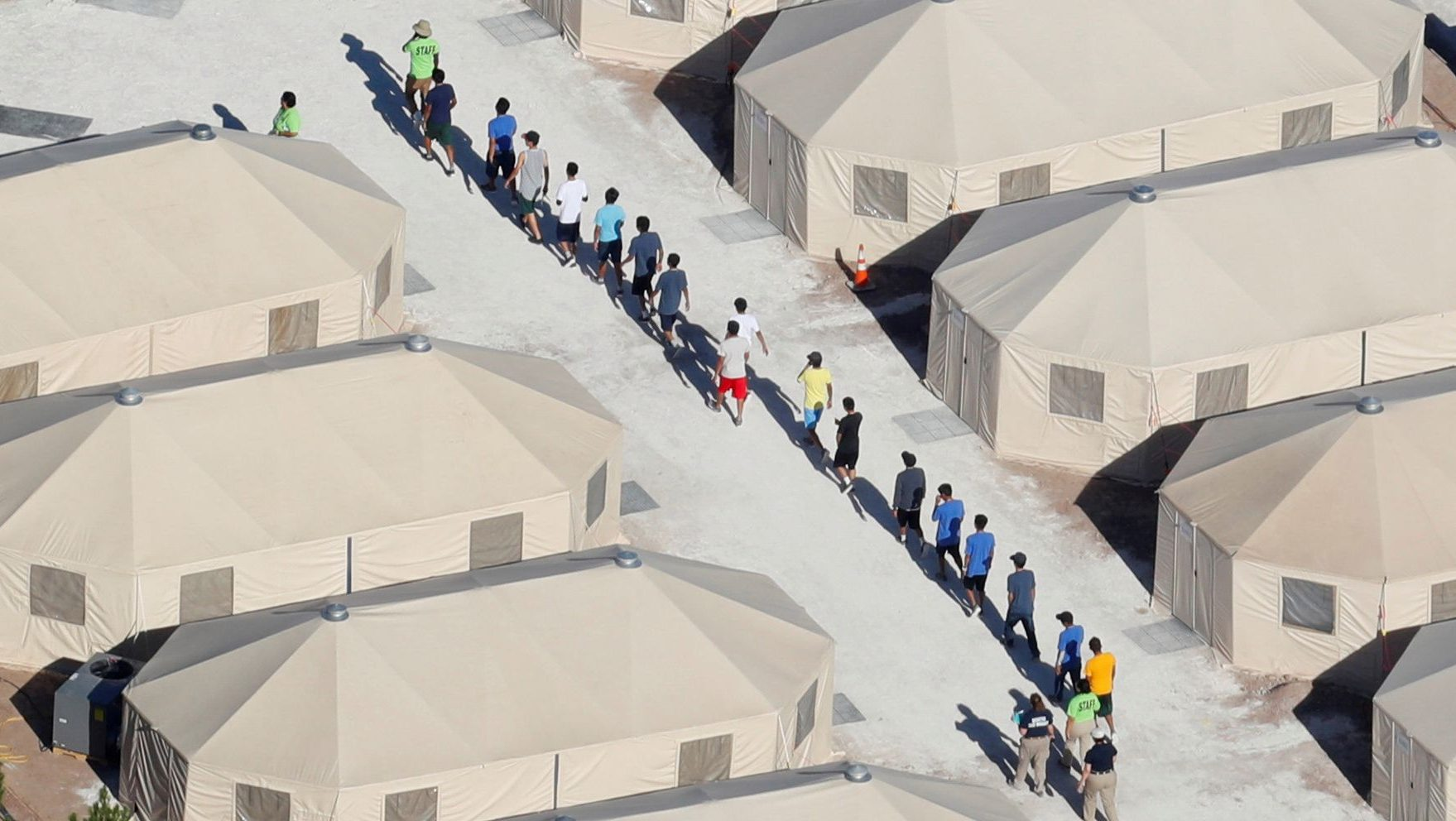 "Immigrant children housed in a tent encampment under Trumps ""zero tolerance"" policy"