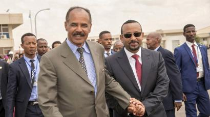 Eritrean President Isaias Afwerki and Ethiopia's Prime Minister Abiy Ahmed and walk together at Asmara International Airport, Eritrea July 9, 2018 in this photo obtained from social media on July 10, 2018.