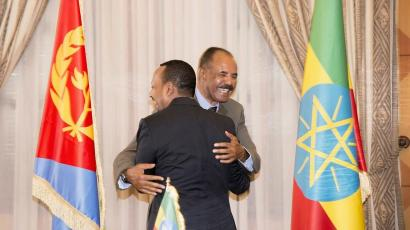 Ethiopia's Prime Minister Abiy Ahmed and Eritrean President Isaias Afwerk embrace at the declaration signing in Asmara, Eritrea July 9, 2018 in this photo obtained from social media on July 10, 2018.