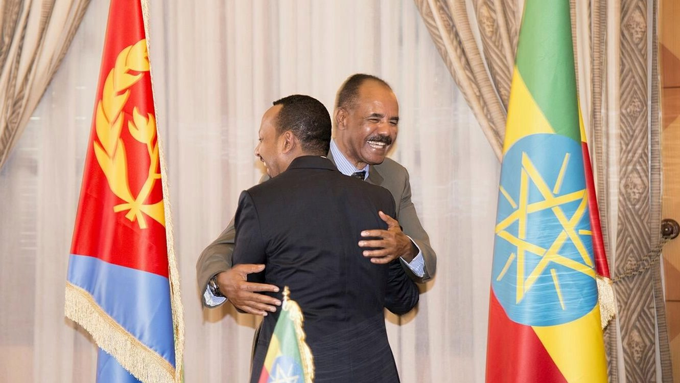 Ethiopia's Prime Minister Abiy Ahmed and Eritrean President Isaias Afwerk embrace at the declaration signing in Asmara