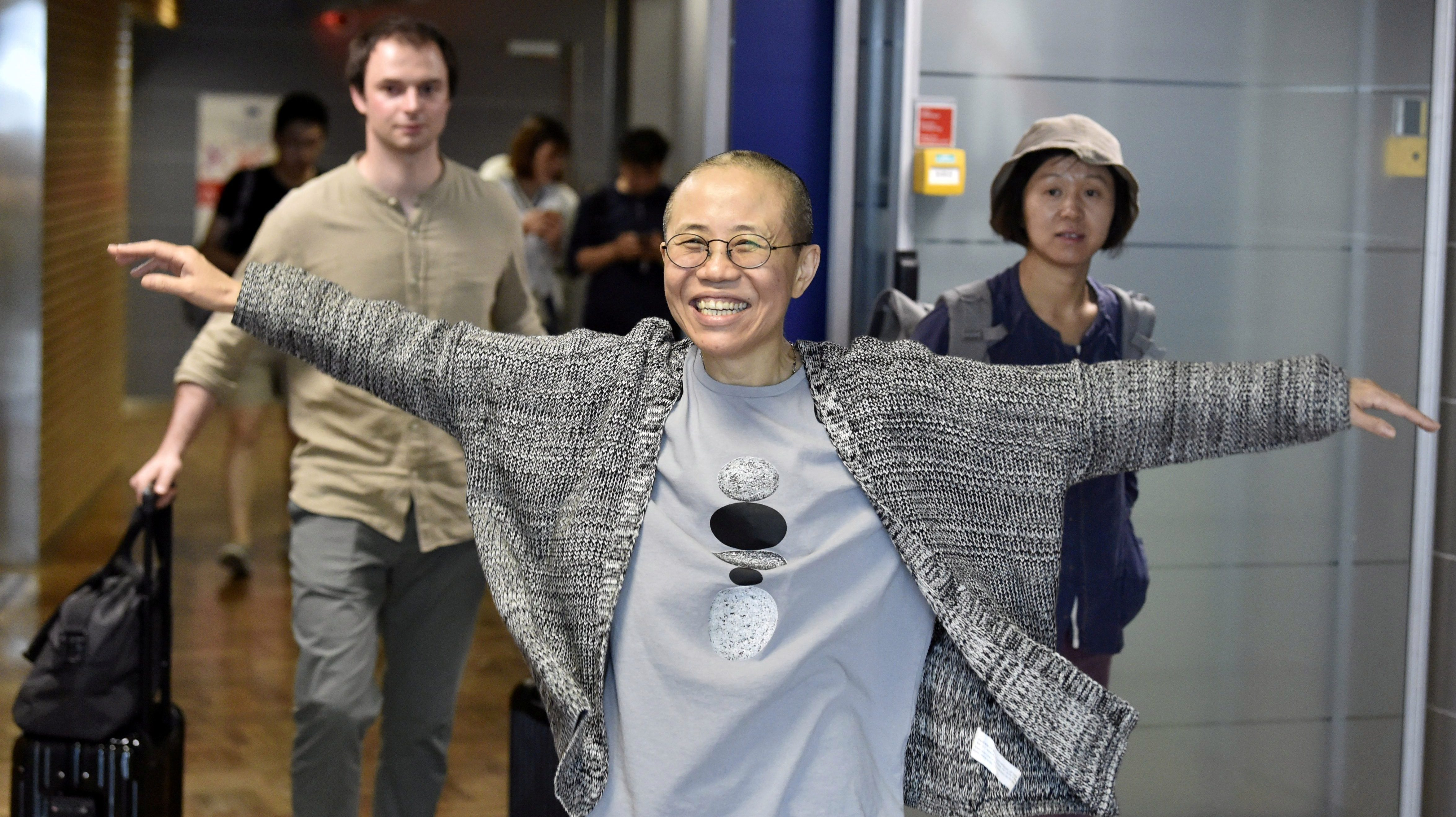 Liu Xia, the widow of Chinese Nobel Peace Prize-winning political dissident Liu Xiaobo, gestures as she arrives at the Helsinki International Airport in Vantaa, Finland, July 10, 2018. Lehtikuva/Jussi Nukari via REUTERS ATTENTION EDITORS - THIS IMAGE WAS PROVIDED BY A THIRD PARTY. NO THIRD PARTY SALES. NOT FOR USE BY REUTERS THIRD PARTY DISTRIBUTORS. FINLAND OUT. NO COMMERCIAL OR EDITORIAL SALES IN FINLAND.     TPX IMAGES OF THE DAY - RC127F47BF20