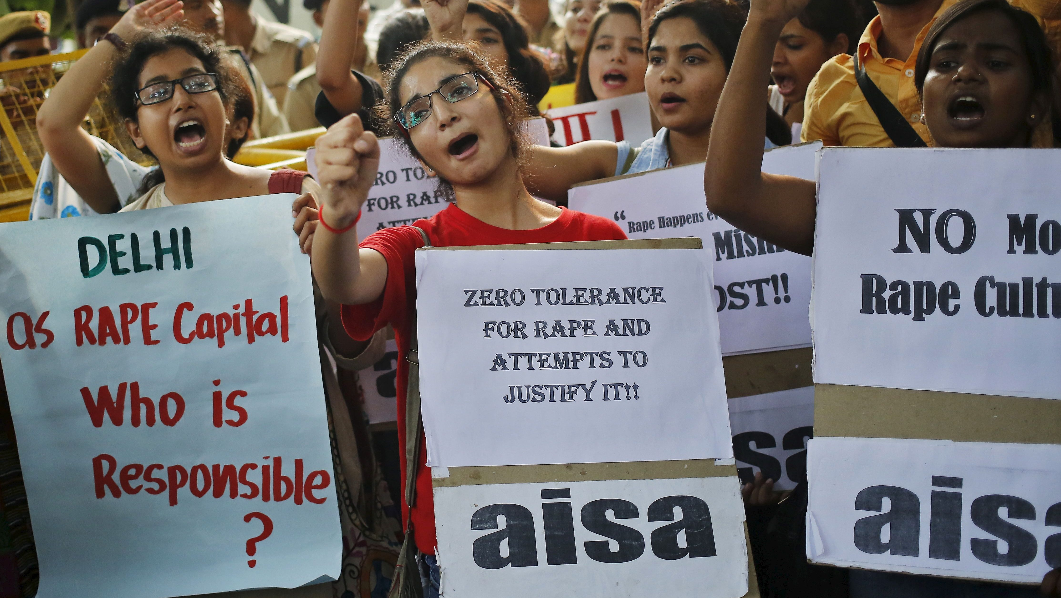 Members of All India Students Association (AISA) shout slogans as they hold placards during a protest outside police headquarters in New Delhi, India, October 18, 2015. Dozens of AISA members on Sunday held a protest against the recent rapes in the capital, the demonstrators said.