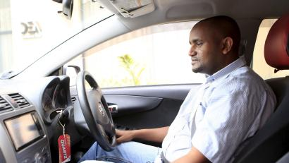 An Uber taxi driver sits in his car in Nairobi March 9, 2016. U.S.-based Uber plans to expand in Tanzania, Uganda and Ghana this year and will focus on convincing traditional taxi drivers to work for the ride-hailing service, Alon Lits, Uber's general manager for sub-Saharan Africa, said.