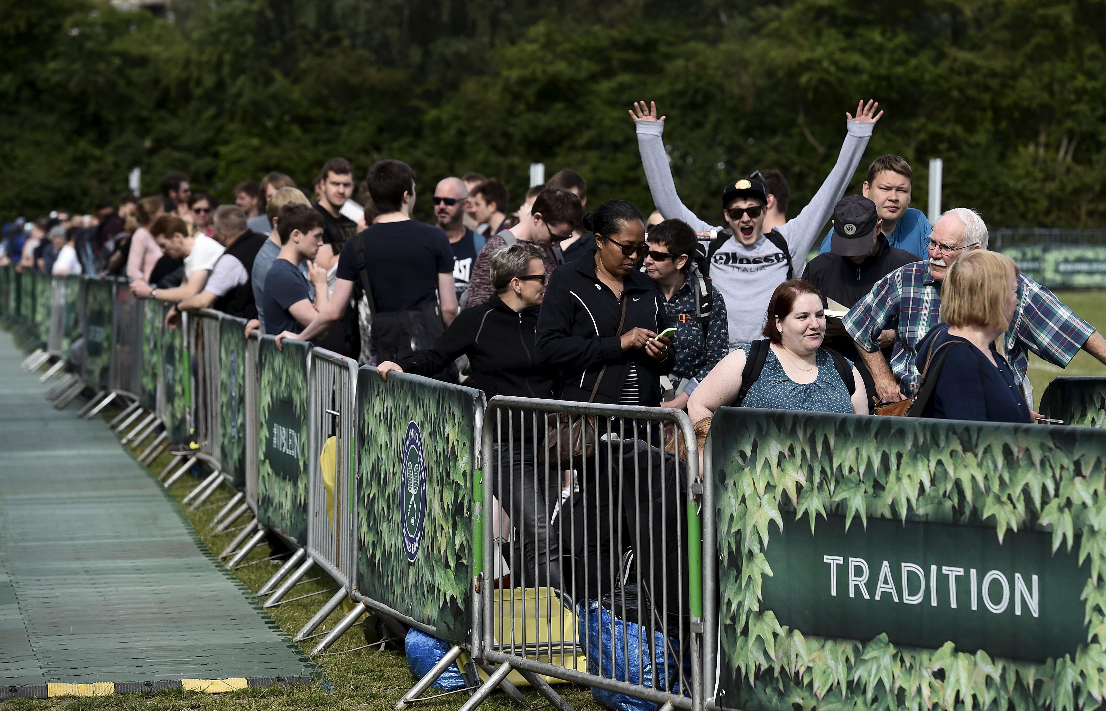 Wimbledon tennis fans wait in line