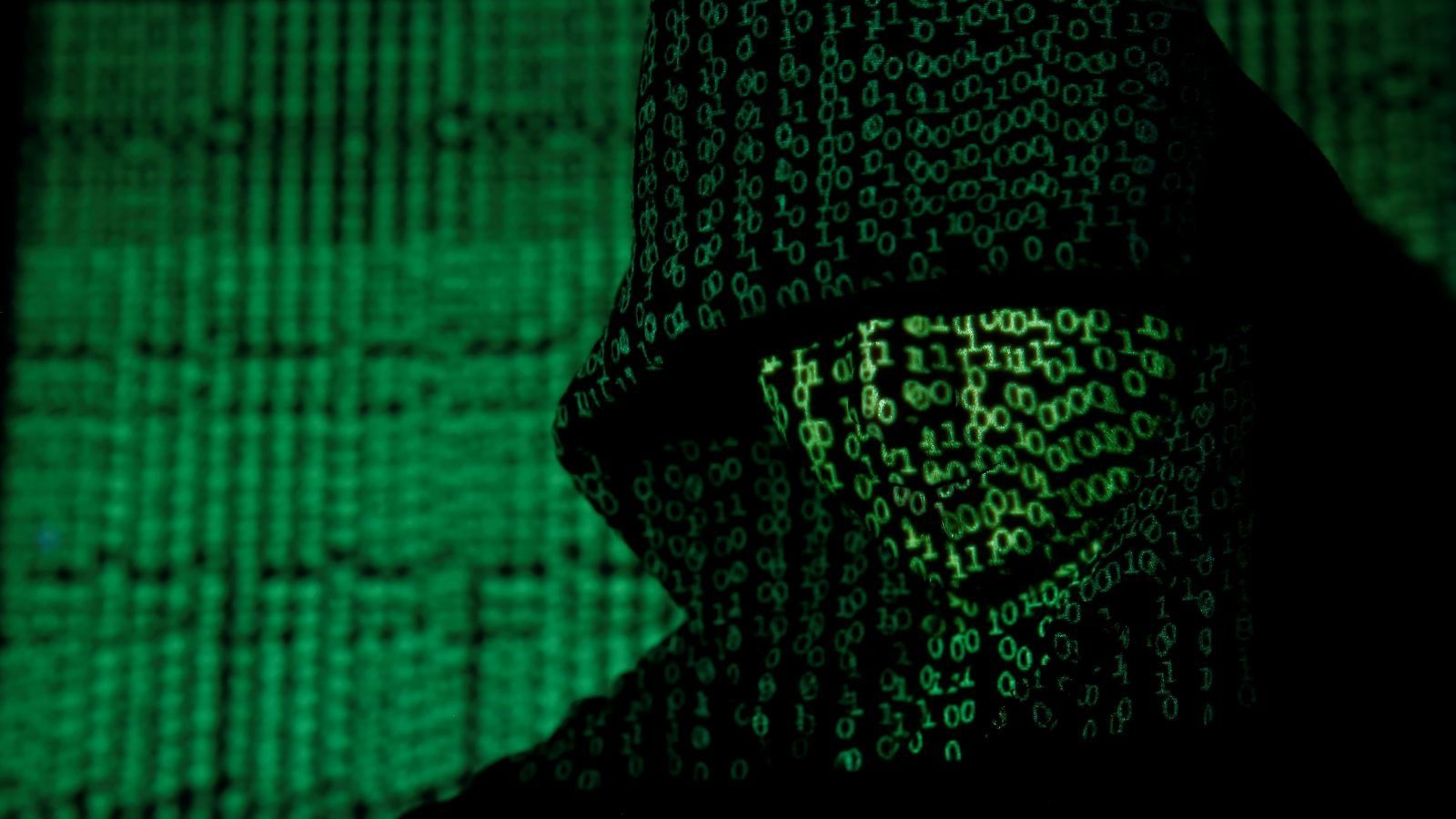 A projection of cyber code on a hooded man is pictured in this illustration picture taken on May 13,  2017. Capitalizing on spying tools believed to have been developed by the U.S. National Security Agency, hackers staged a cyber assault with a self-spreading malware that has infected tens of thousands of computers in nearly 100 countries. REUTERS/Kacper Pempel/Illustration     TPX IMAGES OF THE DAY - RC19EE7DD900