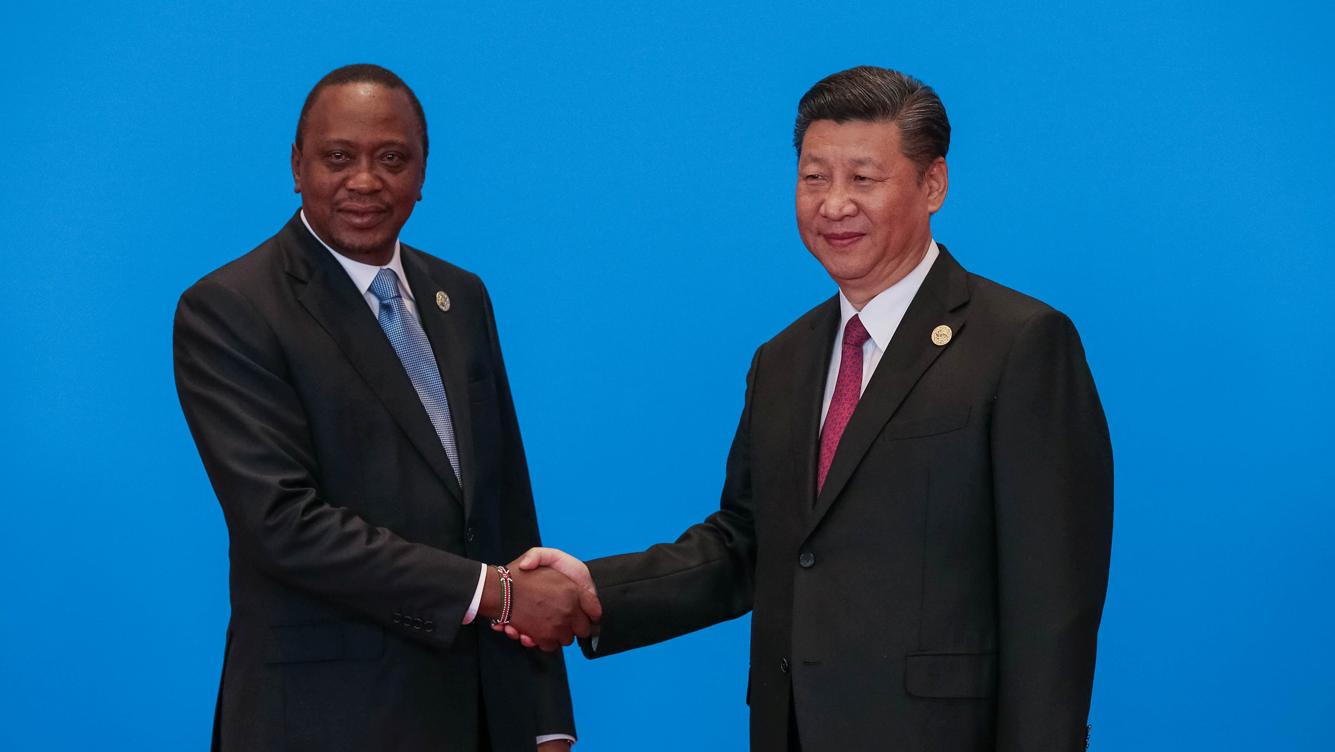 Chinese President Xi Jinping shakes hands with Kenya's President Uhuru Kenyatta during the welcome ceremony for the Belt and Road Forum, at the International Conference Center in Yanqi Lake, north of Beijing, China, May 15, 2017.
