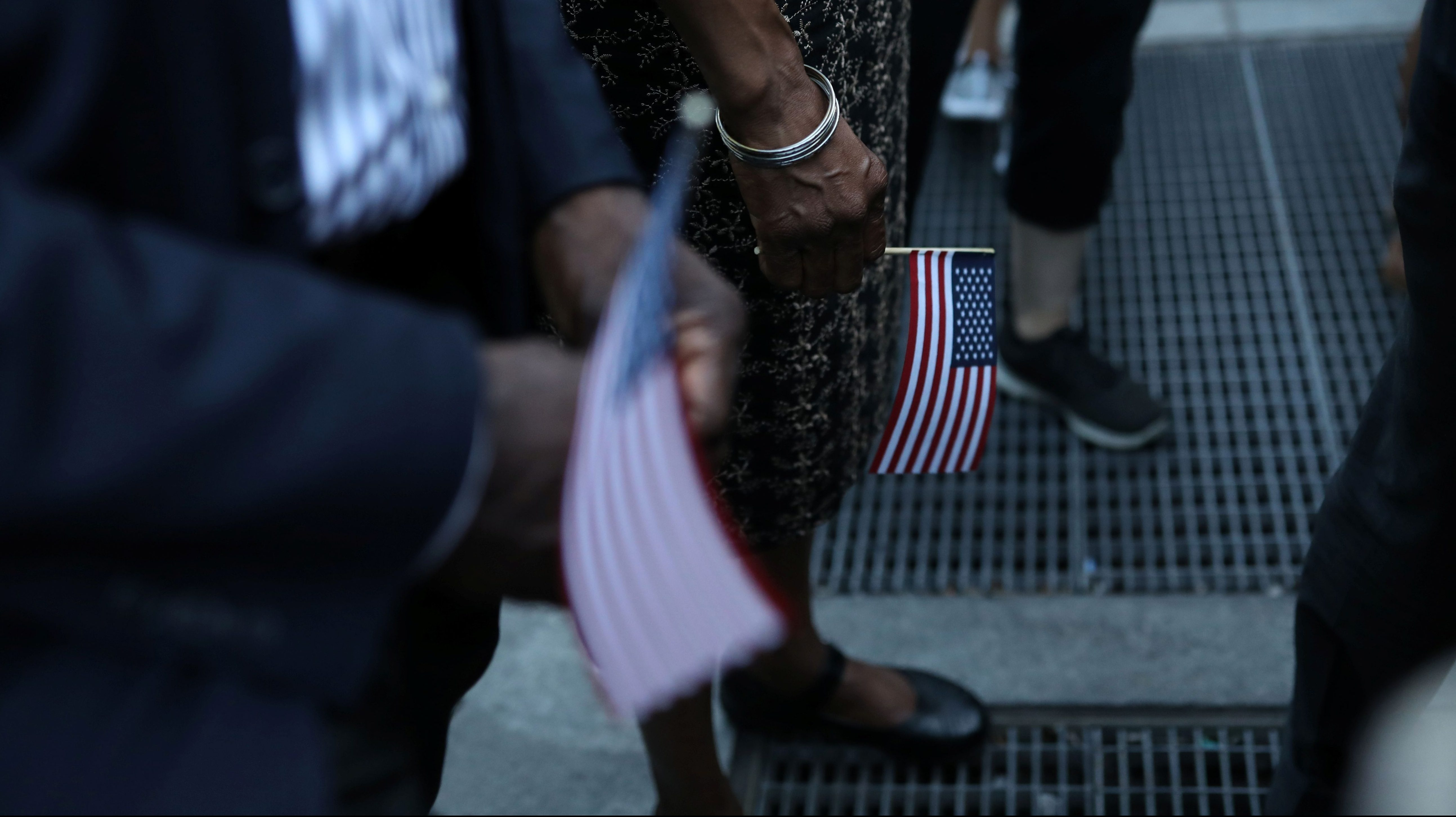 People hold American flags during protests against the planned dissolution of DACA in Manhattan, New York City