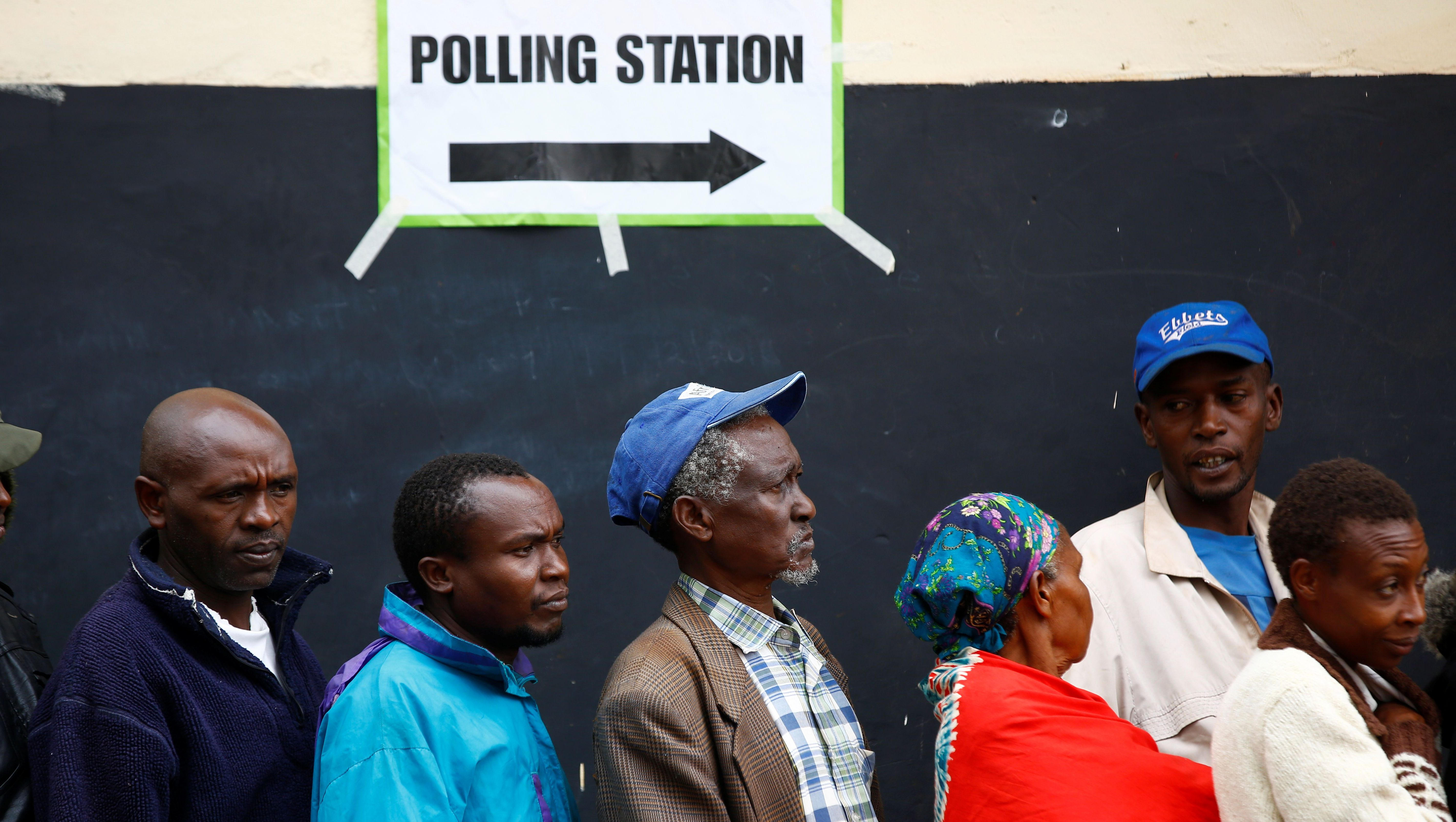 People queue to cast their votes at a polling station during a presidential election re-run in Gatundu, Kenya October 26, 2017.