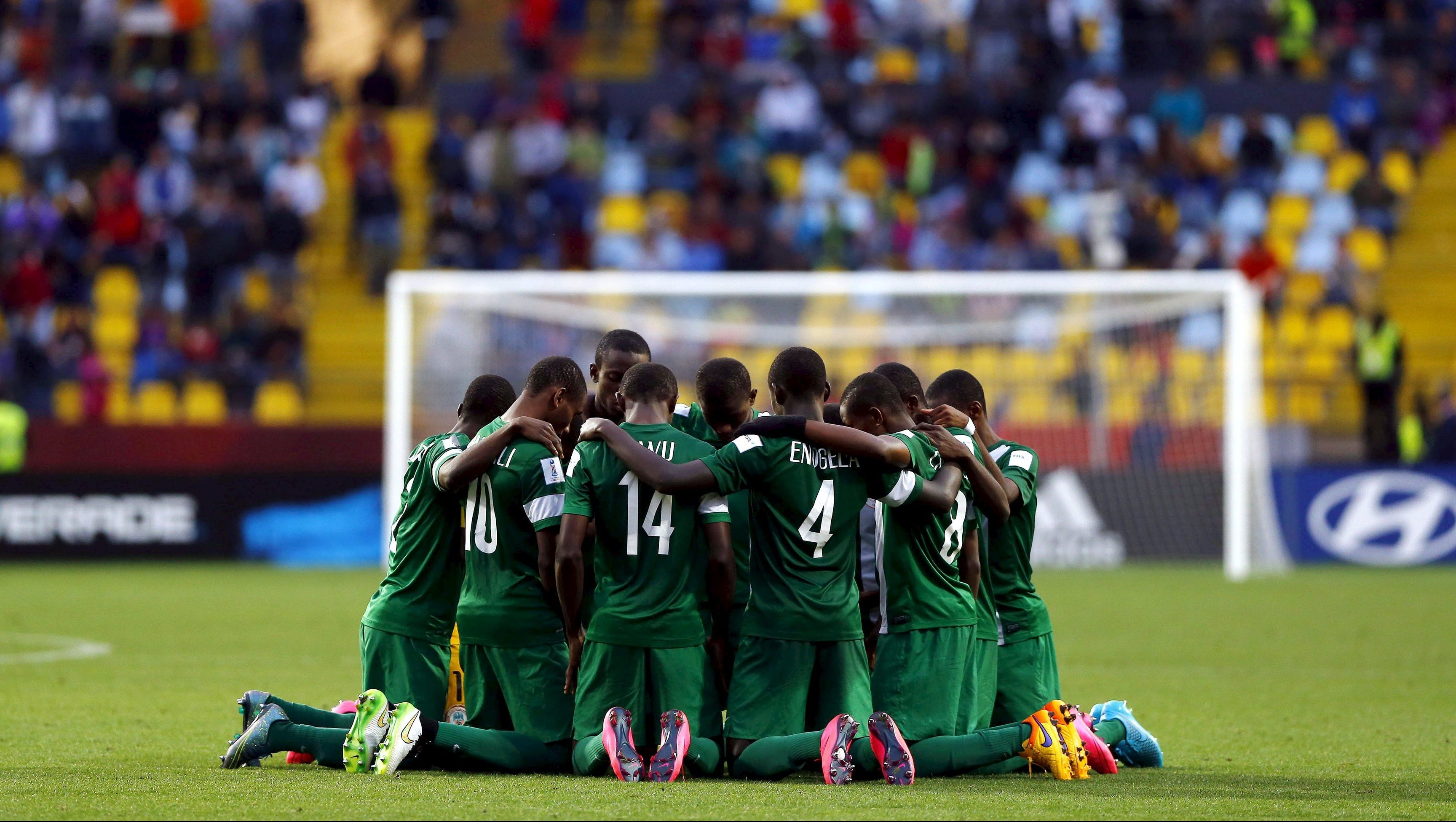 Nigeria's soccer team players pray before starting the second half of their final match against Mali at the U17 World Cup in Vina del Mar city