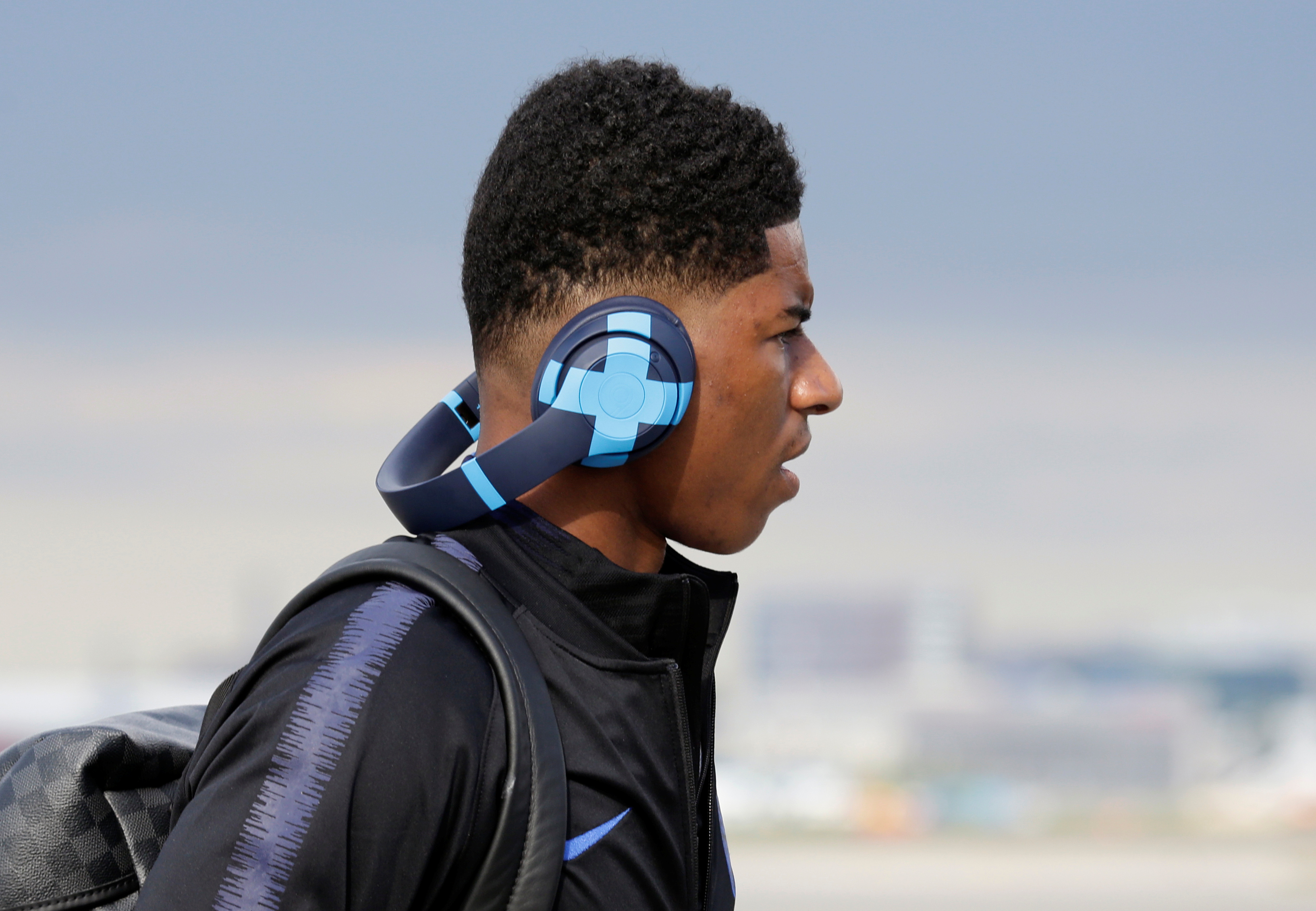 Soccer Football - World Cup - England Arrival - Pulkovo Airport, Saint Petersburg, Russia - June 12, 2018 England's Marcus Rashford during their arrival REUTERS/Anton Vaganov - RC12A62FCE10