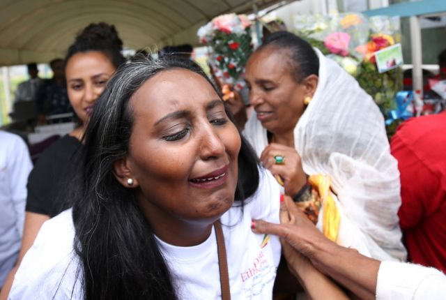 Senait Zaro, reacts as she meets her family for the first time in fifteen years, at Asmara International Airport, who arrived aboard the Ethiopian Airlines ET314 flight in Asmara, Eritrea July 18, 2018.