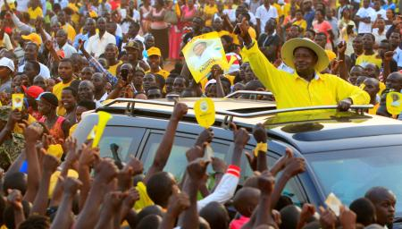 FILE PHOTO: Uganda's President and the presidential candidate Yoweri Museveni of the ruling party National Resistance Movement (NRM) waves to his supporters as he arrives at a campaign rally ahead of the February 18 presidential elections in Entebbe, Uganda February 10, 2016.