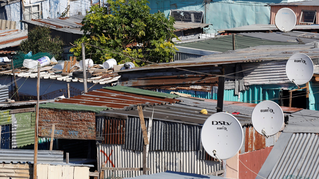 Satellite dishes connect township residents to South Africa's DSTV television network, owned by telecommunications giant Naspers, in Khayelitsha township, Cape Town, May 19, 2017.    REUTERS/Mike Hutchings - RC1DE3952110