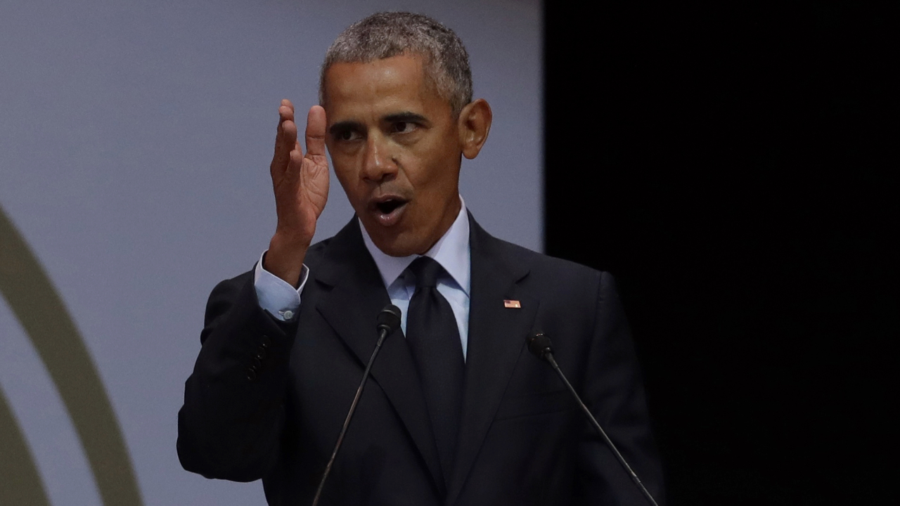 U.S. President Barack Obama, at podium delivers his speech at the 16th Annual Nelson Mandela Lecture at the Wanderers Stadium in Johannesburg, South Africa, Tuesday, July 17, 2018. In his highest-profile speech since leaving office, Obama urged people around the world to respect human rights and other values under threat in an address marking the 100th anniversary of anti-apartheid leader Nelson Mandela's birth. (AP Photo/Themba Hadebe)