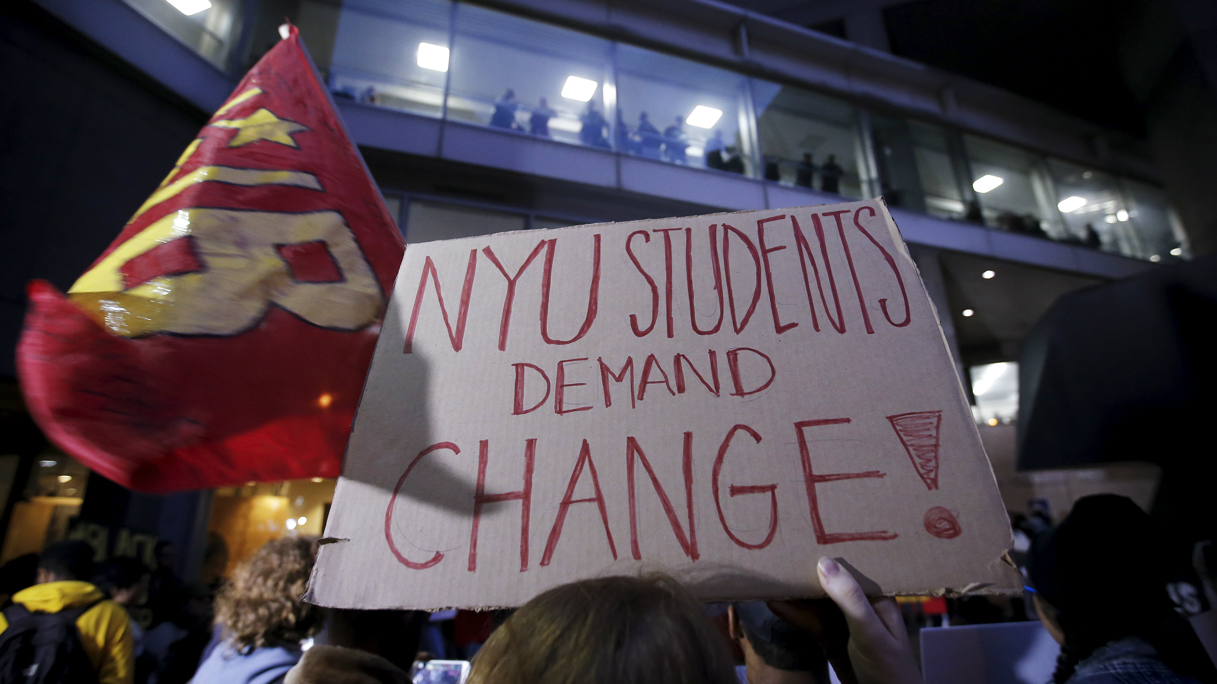 Students hold up signs as they attend a demonstration calling for lower tuition at Hunter College in the Manhattan borough of New York November 12, 2015. Students held rallies on college campuses across the United States on Thursday to protest ballooning student loan debt for higher education and rally for tuition-free public colleges and a minimum wage hike for campus workers.