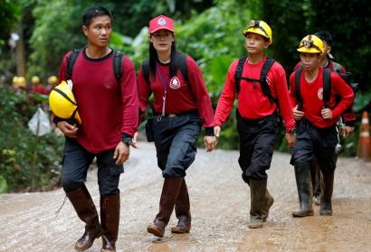 Rescue workers arrive at the Tham Luang cave complex,
