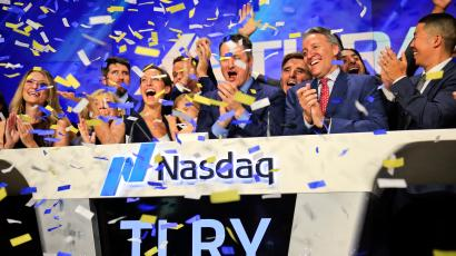 Brendan Kennedy, third from right front, CEO and founder of British Columbia-based Tilray Inc., a major Canadian marijuana grower, leads cheers as confetti falls to celebrate his company's IPO (TLRY) at Nasdaq, Thursday, July 19, 2018, in New York. Medical marijuana is legal in Canada, and on Oct. 17, the country will become the first major industrialized nation to legalize its production and sale for recreational use.
