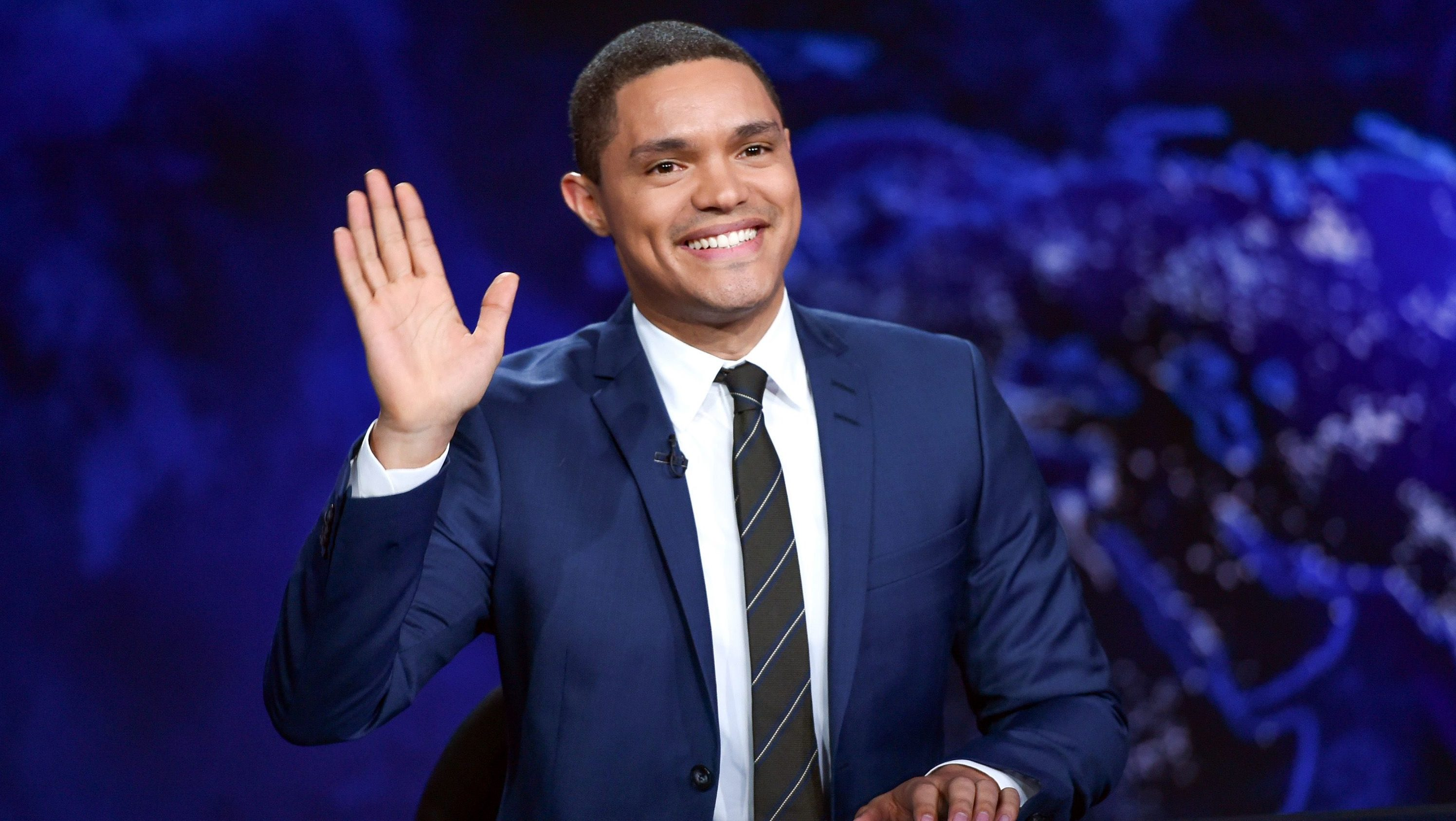 """In this Sept. 29, 2015 file photo, Trevor Noah gestures on the set during a taping of """"The Daily Show with Trevor Noah"""" in New York City."""