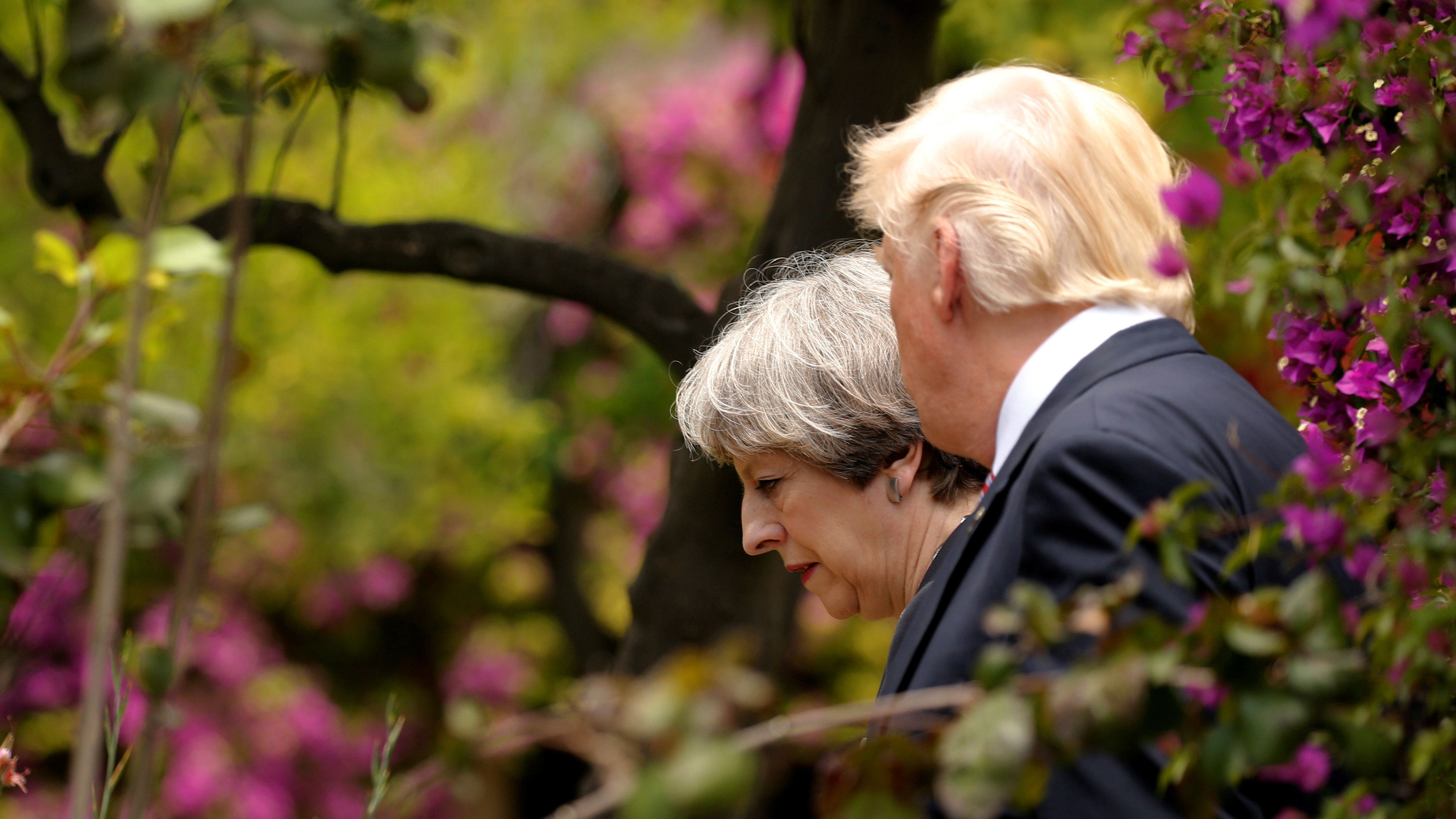 U.S. President Donald Trump talks to Britain's Prime Minister Theresa May at the G7 Summit in Taormina, Sicily