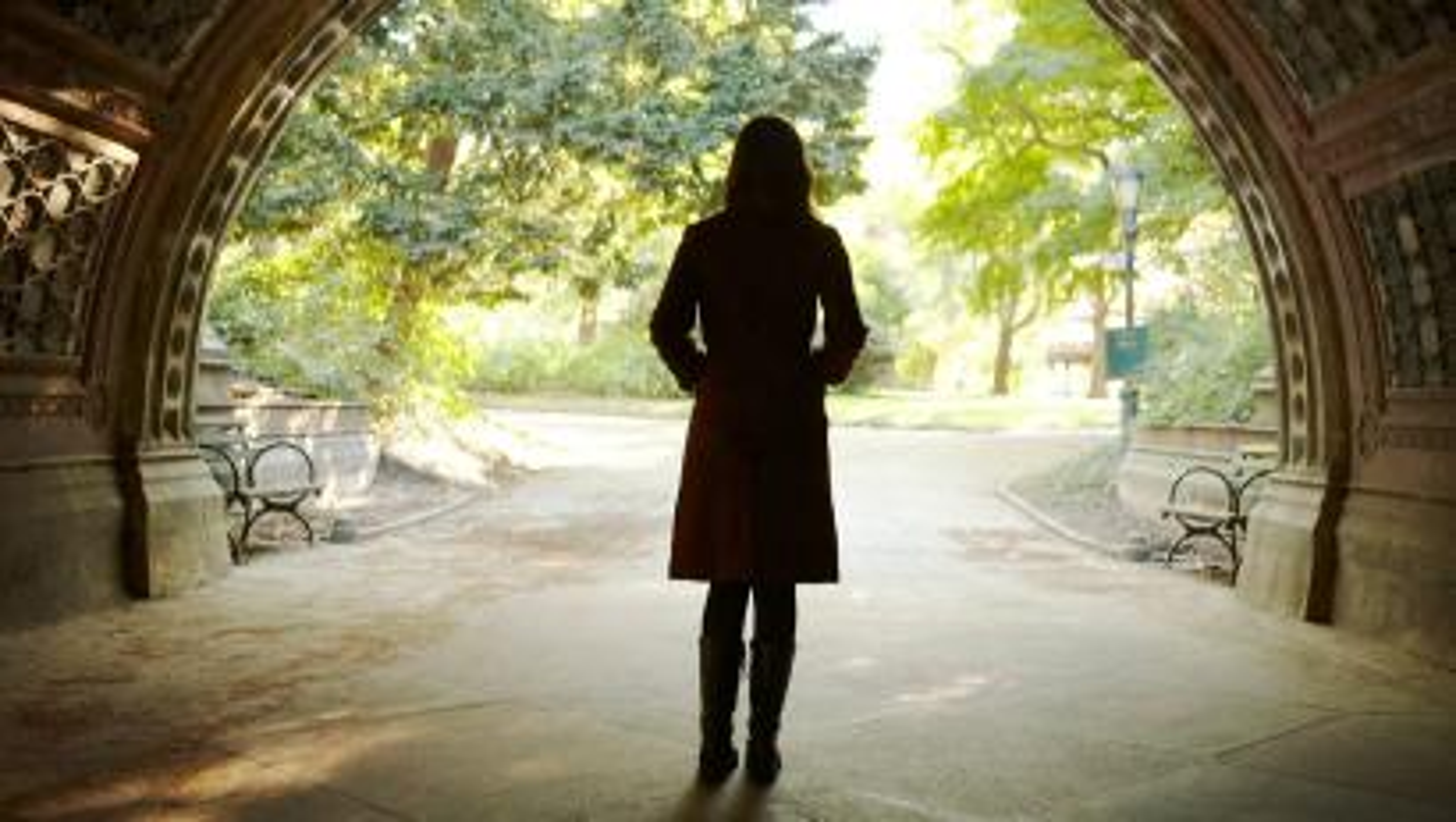 Woman walking through tunnel