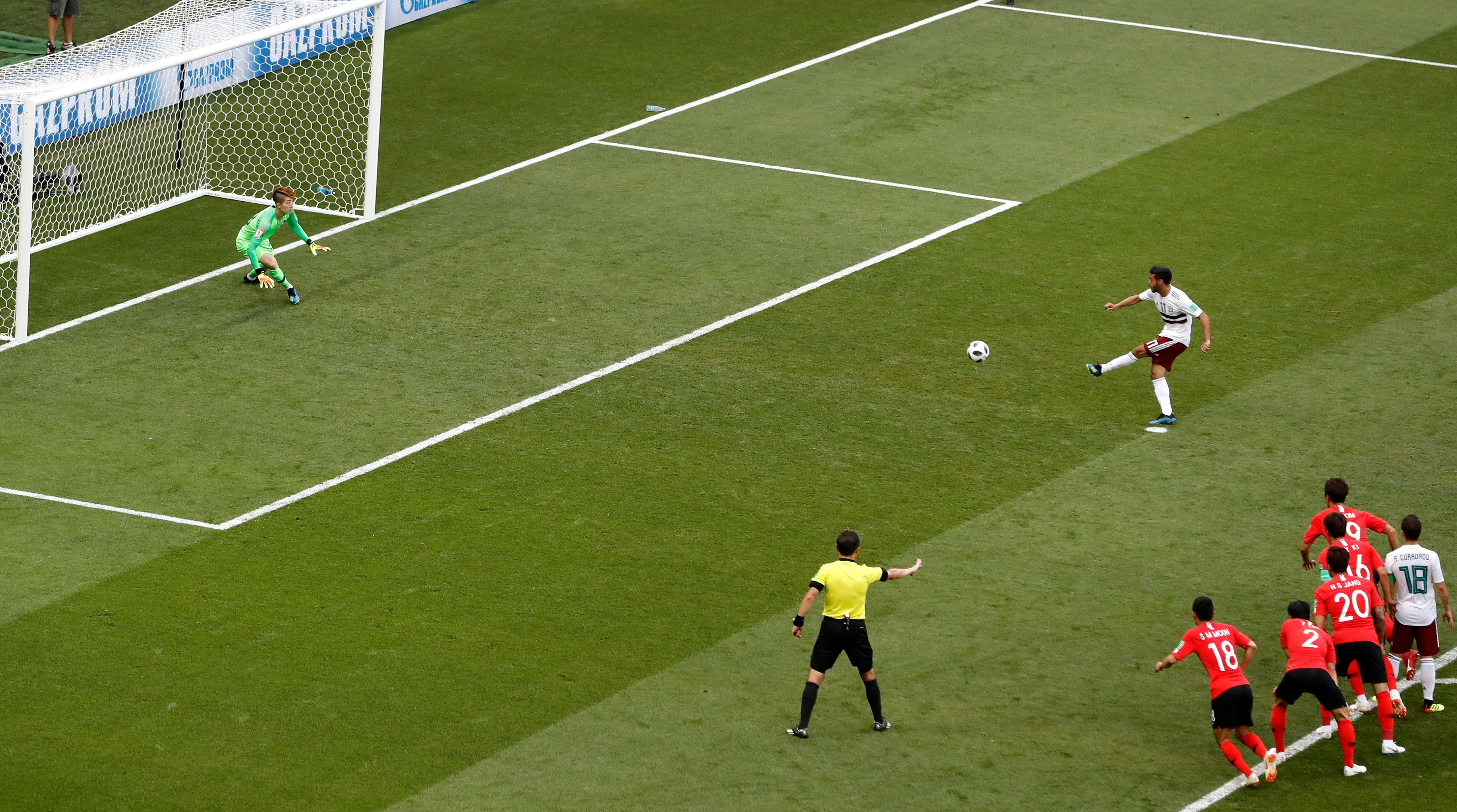 Mexico's Carlos Vela, right, kicks the ball to score his team's first goal from a penalty during the group F match between Mexico and South Korea at the 2018 soccer World Cup in the Rostov Arena in Rostov-on-Don, Russia, Saturday, June 23, 2018.