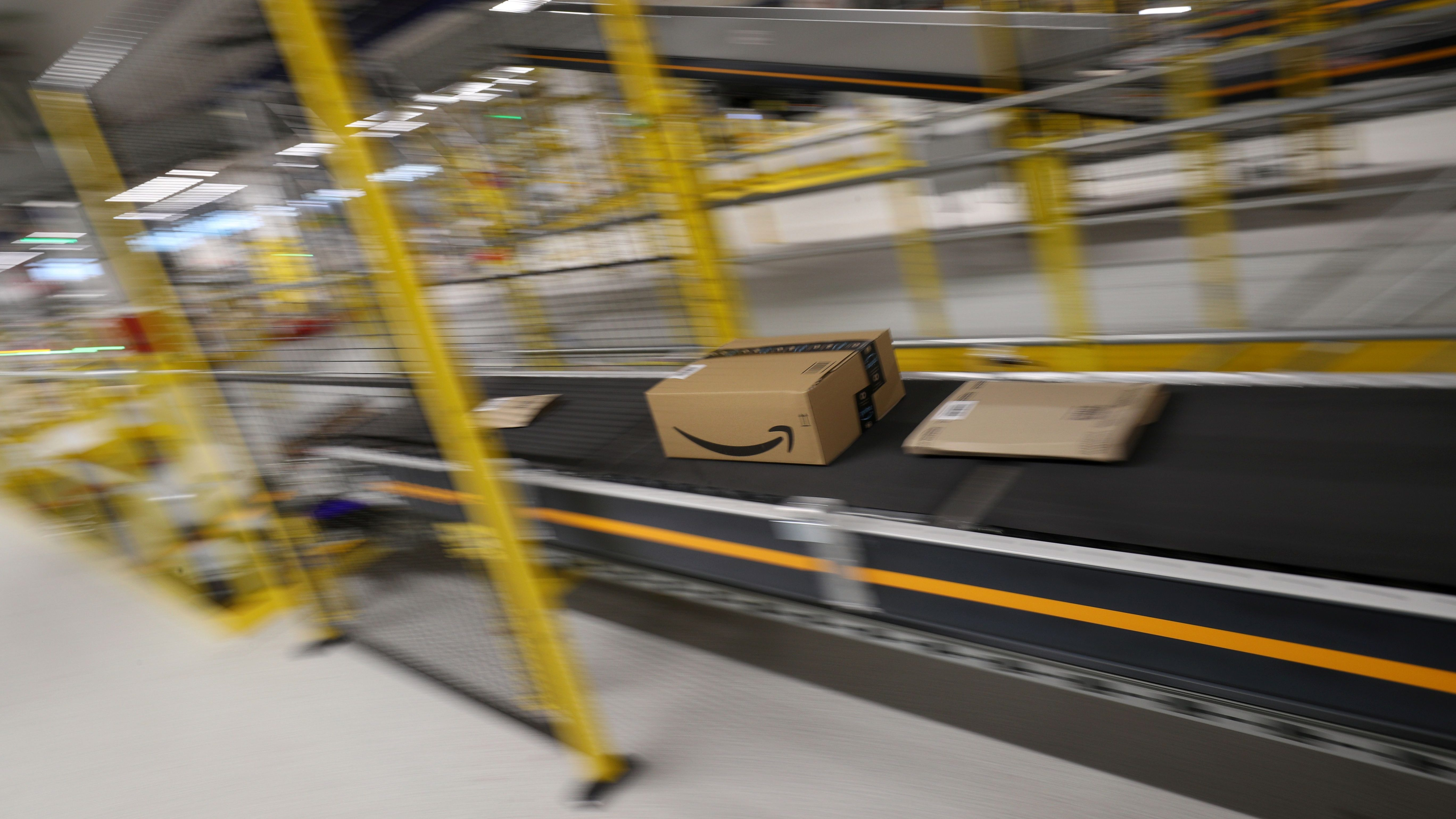 Boxes are moved on conveyor belts at Amazon distribution center in El Prat de Llobregat, near Barcelona, Spain, March 15, 2018. REUTERS/Albert Gea - RC1F1F177600